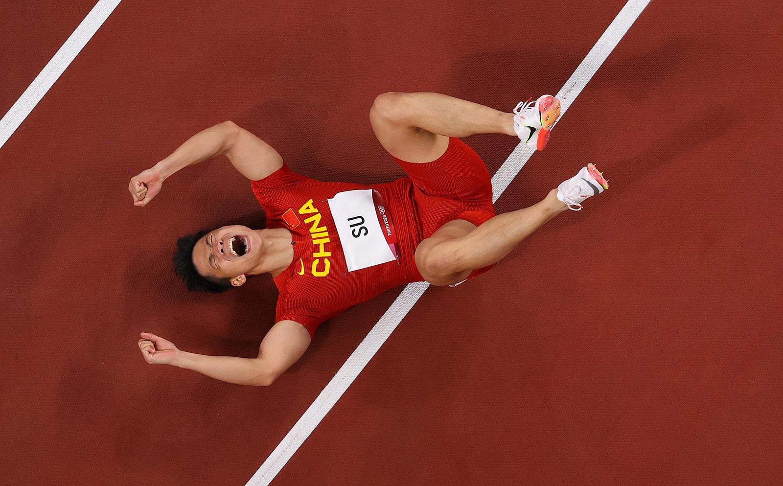 China's Su Bingtian celebrates after winning his 100 meter semifinal on Sunday.