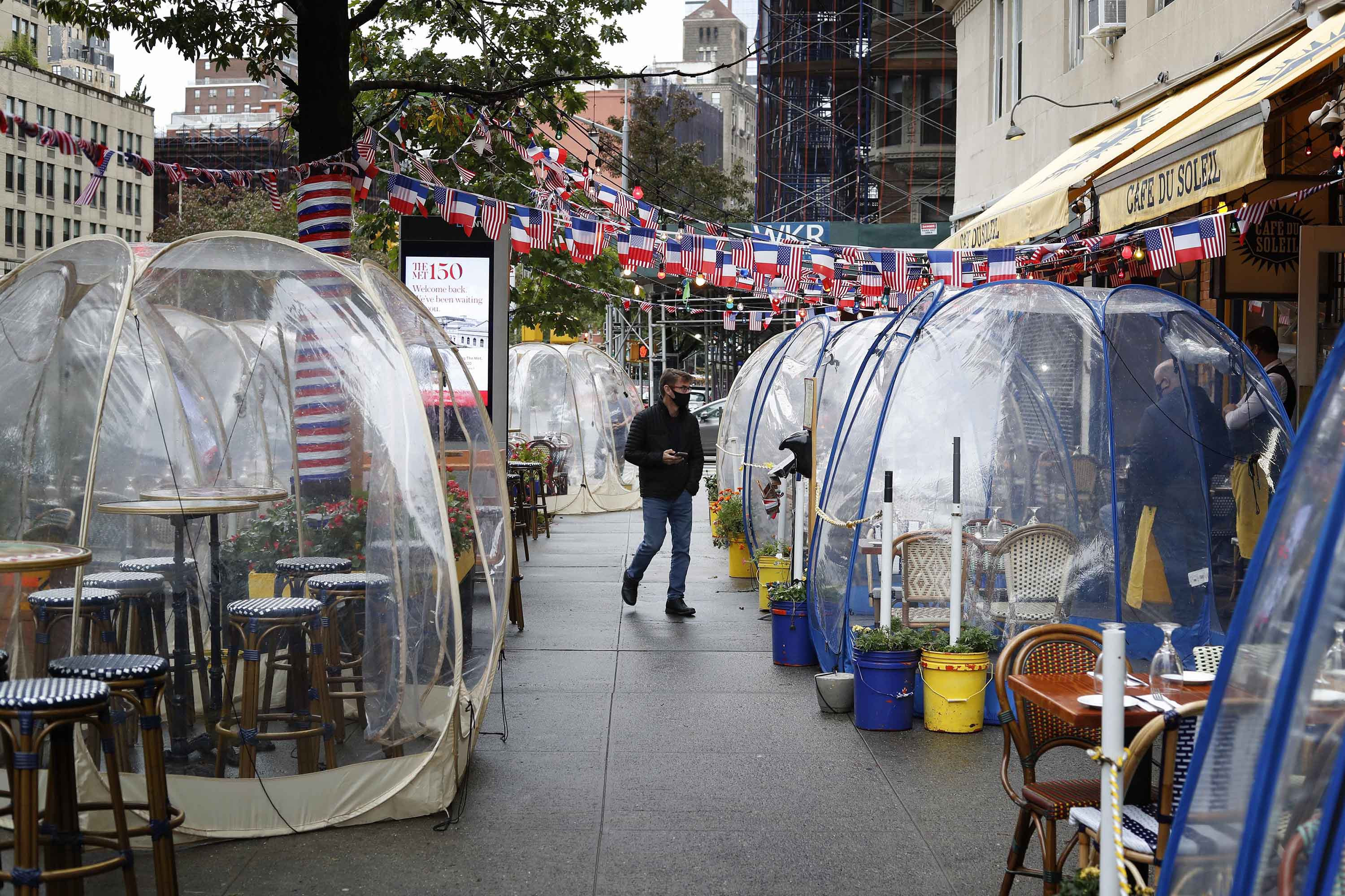 Transparent social distancing bubble tents are set up for diners outside a restaurant in Manhattan, New York, on October 13.