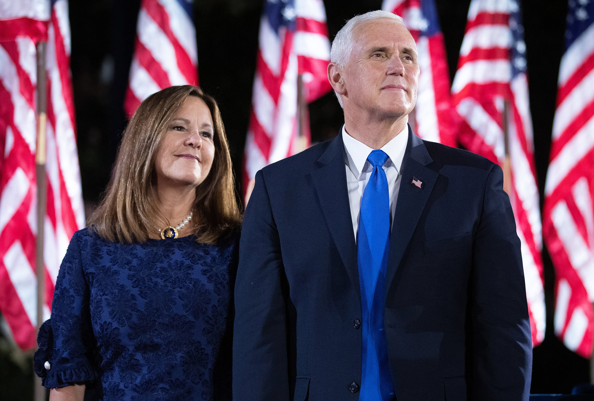 Vice President Mike Pence and his wife Karen Pence join Trump administration officials on stage after President Donald Trump delivered his acceptance speech for the Republican presidential nomination on the South Lawn of the White House August 27 in Washington, DC.