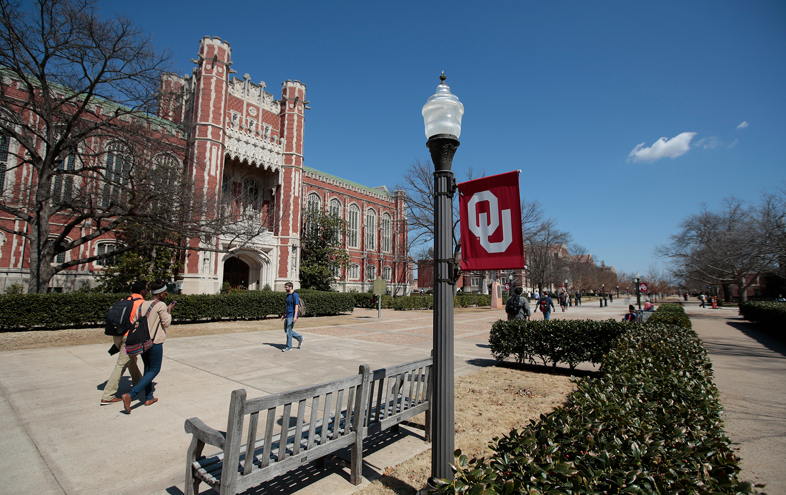 In this March 11, 2015 photo, students walk between classes in front of the Bizzell Memorial Library at the University of Oklahoma in Norman, Oklahoma.