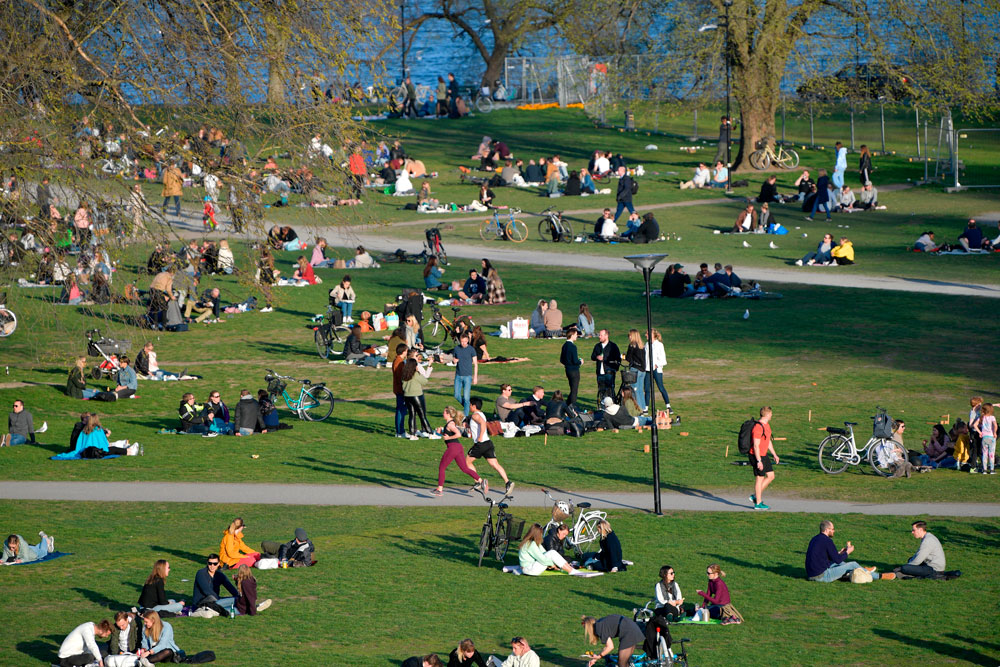 People enjoy warm and spring-like weather with high temperatures on April 22, in Stockholm.