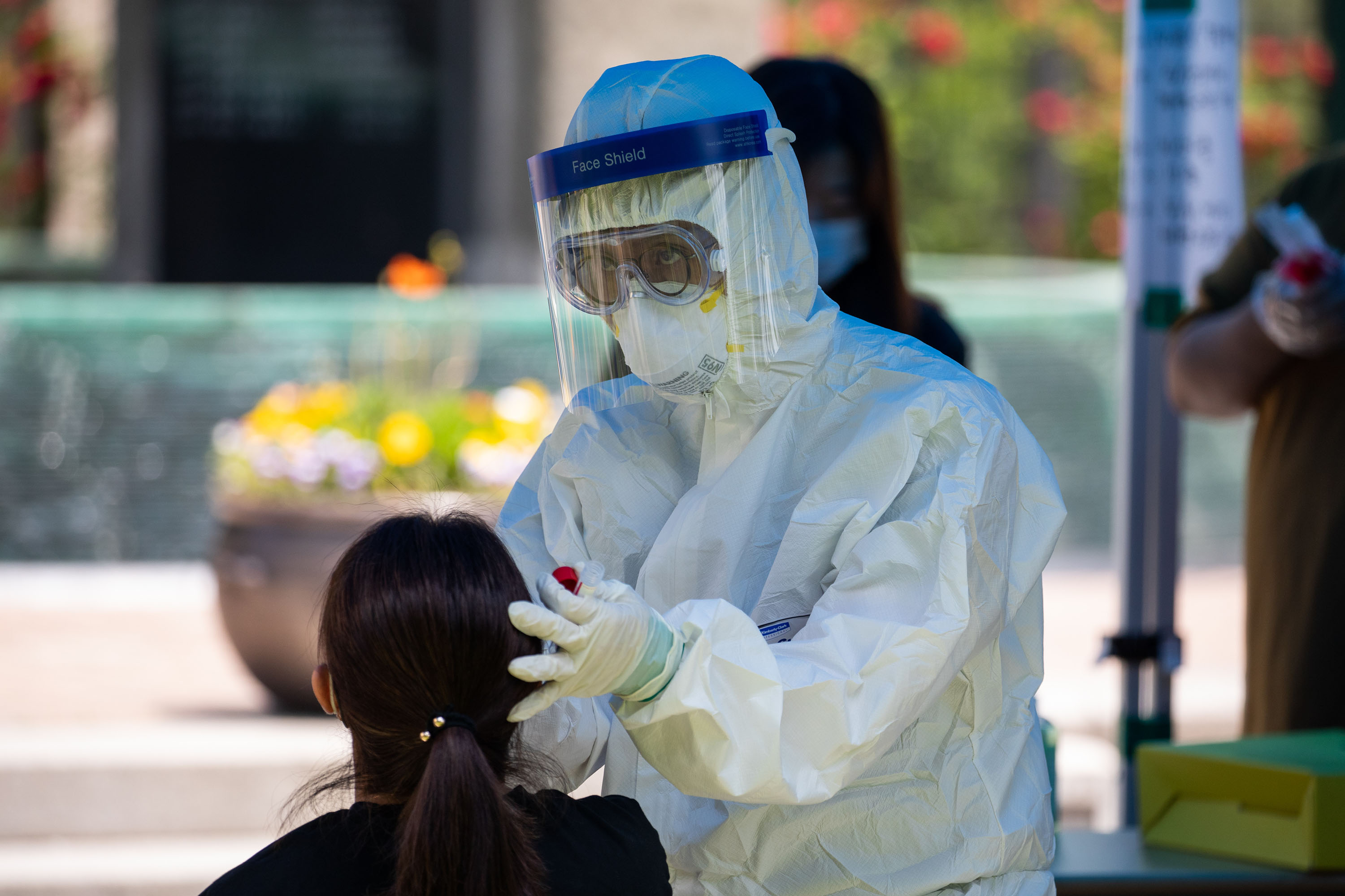 A medical worker collects a sample at a coronavirus testing station in Seoul, South Korea, on May 29.
