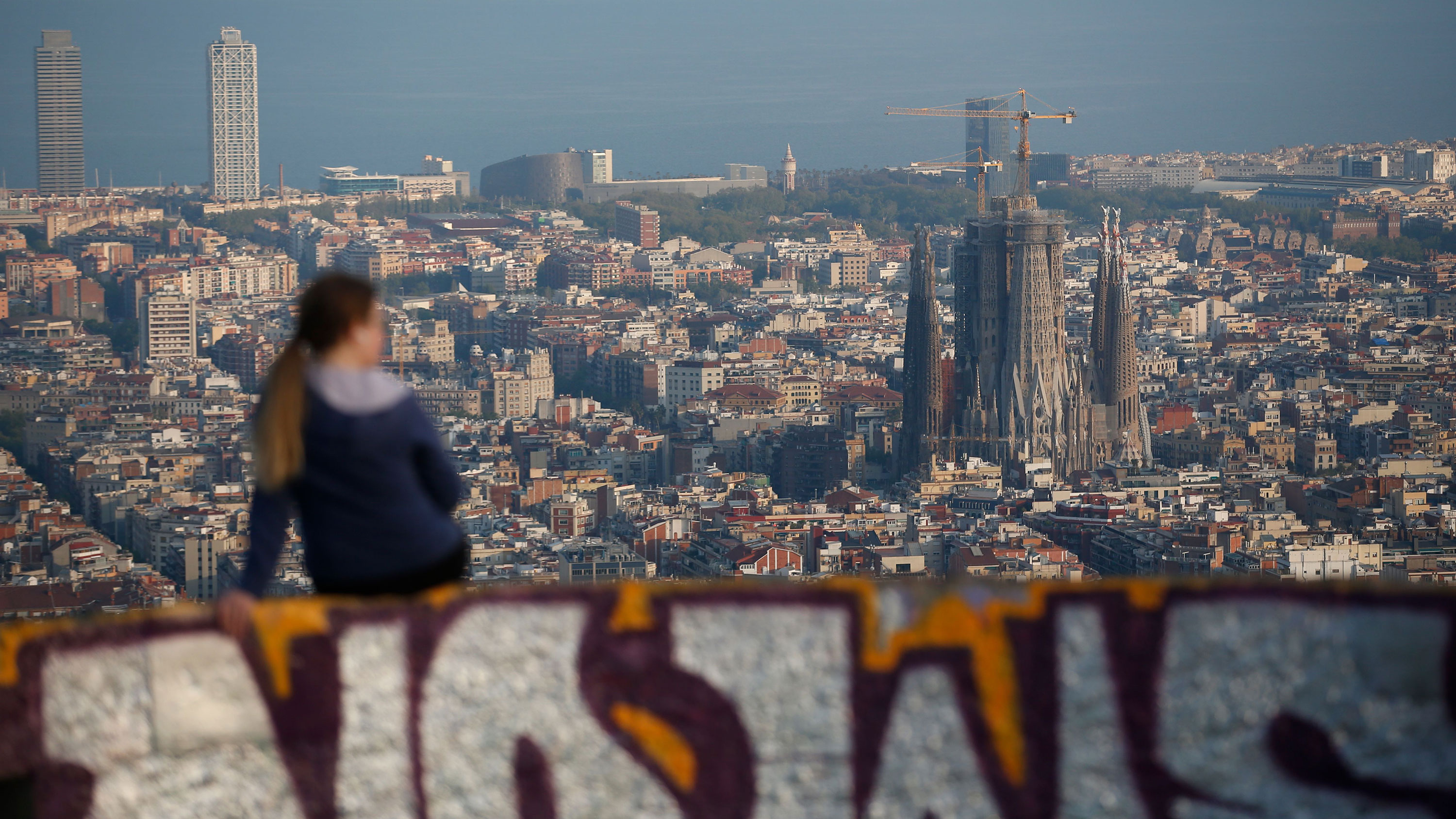 A woman looks over Barcelona on April 10, during a national lockdown to prevent the spread of the Covid-19 disease.