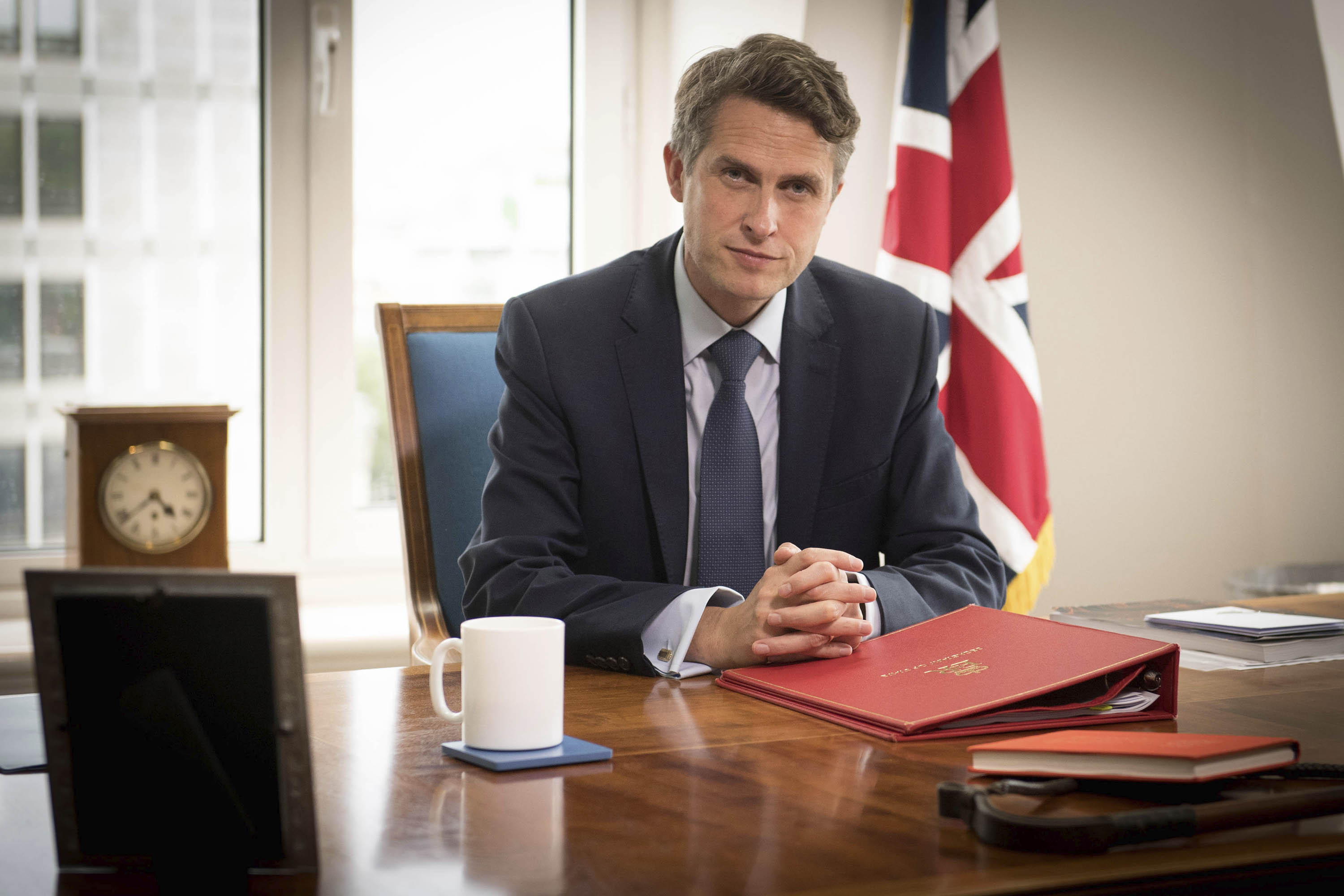 Britain's Secretary of State for Education Gavin Williamson poses for a photo in his office at the Department of Education in London on August 17.