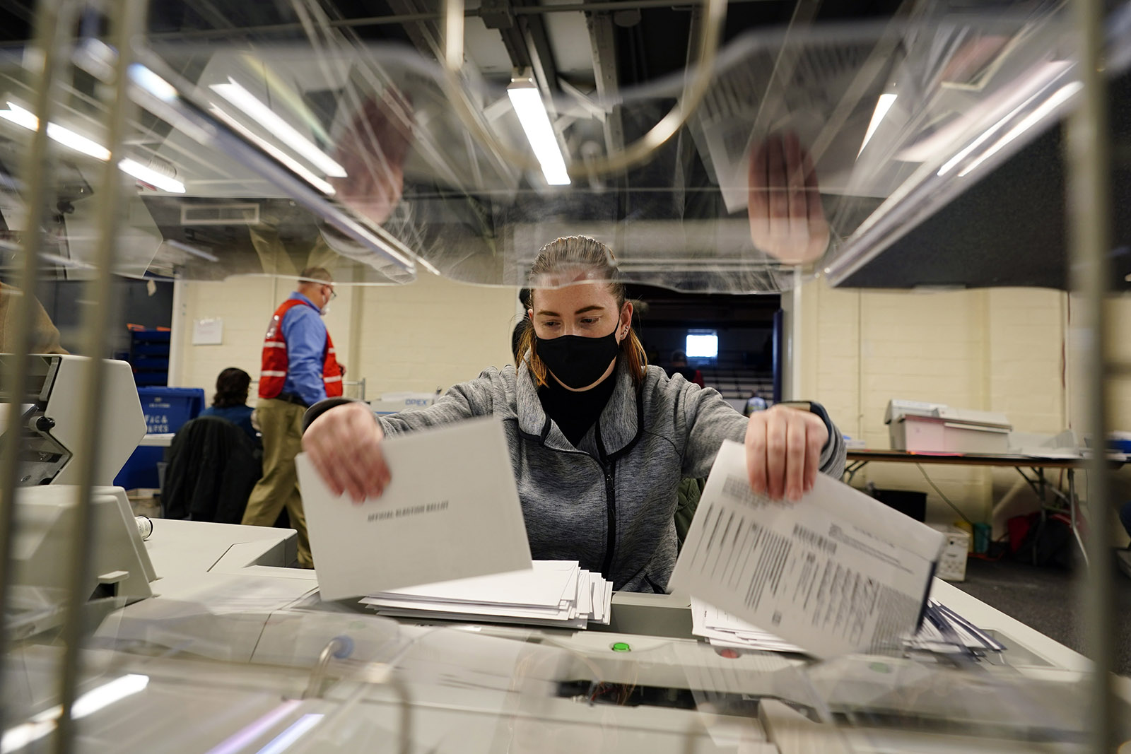 Chester County, Pennsylvania election worker Kristina Sladek opens mail-in and absentee ballots for the 2020 General Election in the United States at West Chester University on Tuesday.