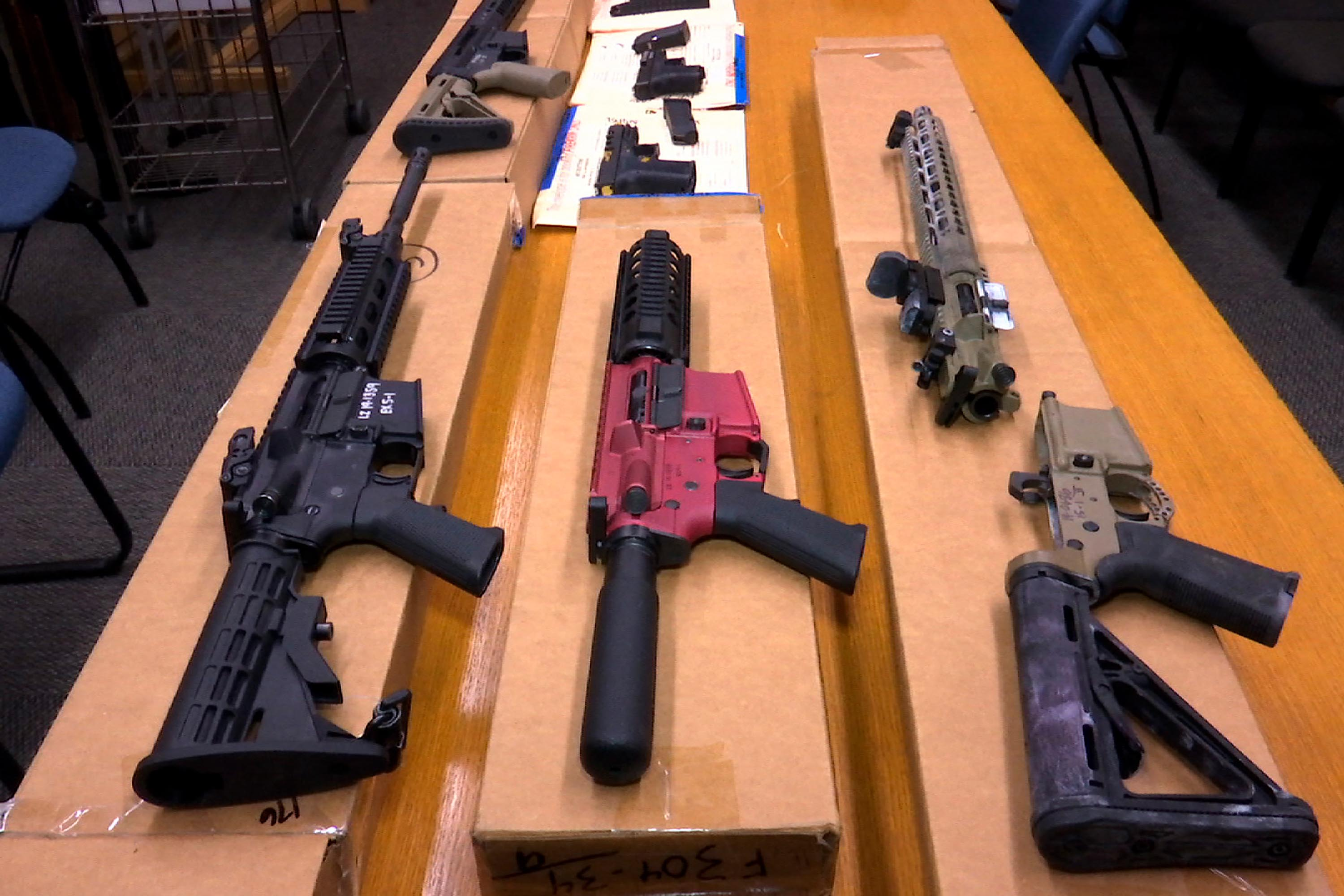 """This November 2019 file photo shows """"ghost guns"""" on display at the headquarters of the San Francisco Police Department in San Francisco."""