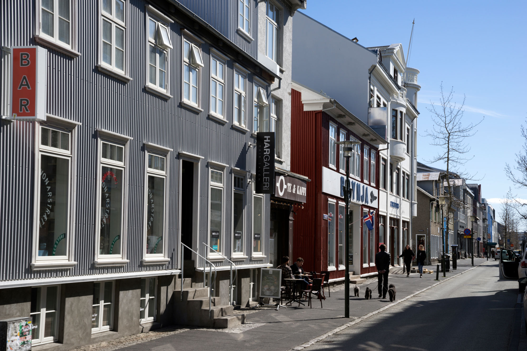 People walk down a street in downtown Reykjavik, Iceland, on April 30.