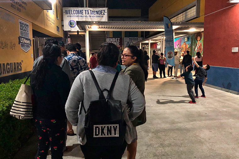Voters wait to cast their ballots at Mendez High School in the Boyle Heights section of Los Angeles, Tuesday, March 3.