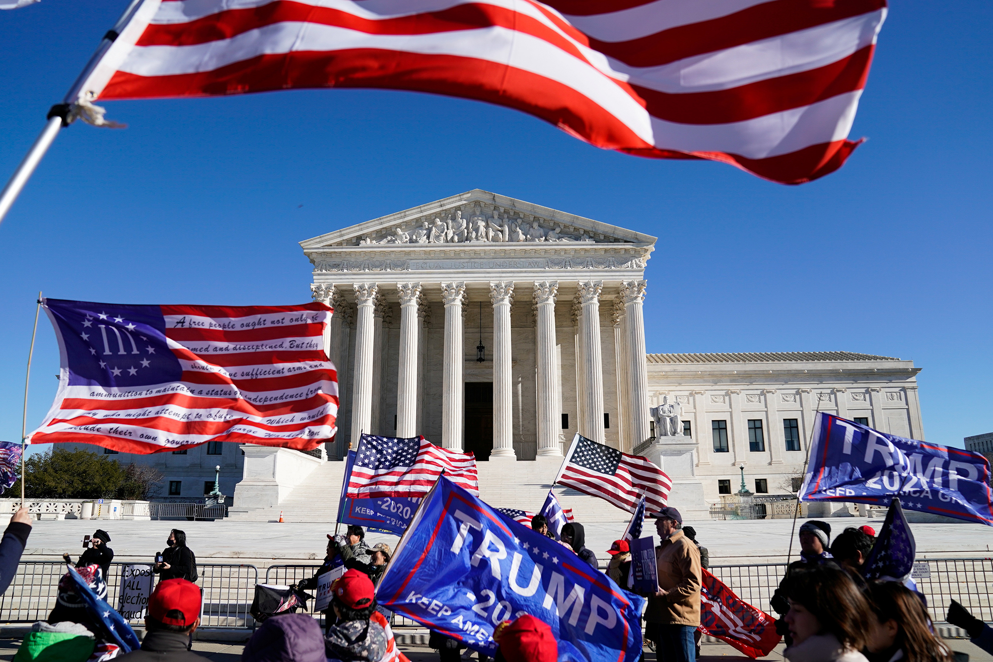 """People participate in a """"Stop the Steal"""" protest outside the U.S. Supreme Court in support of President Donald Trump in Washington on December 8."""