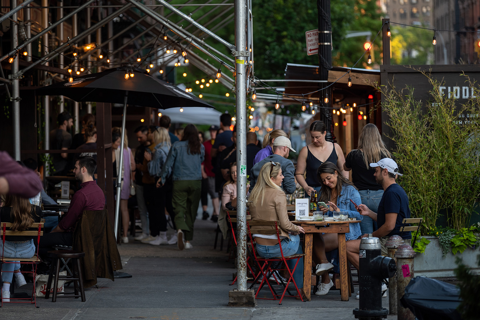 Customers dine outdoors at Fiddlesticks Bar on Memorial Day on May 31 in New York.