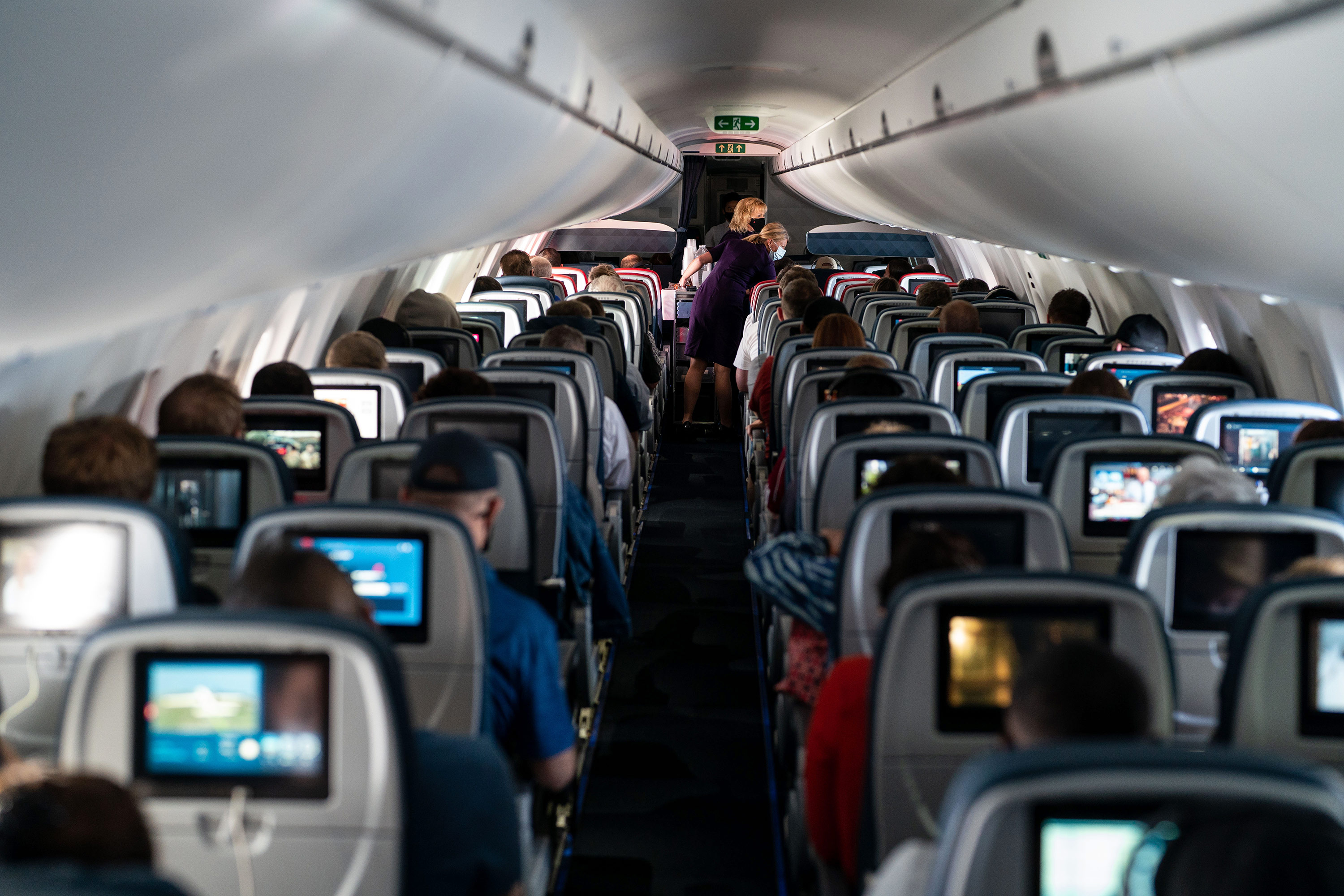 Passengers sit aboard a Delta Airlines flight on Friday, May 21.