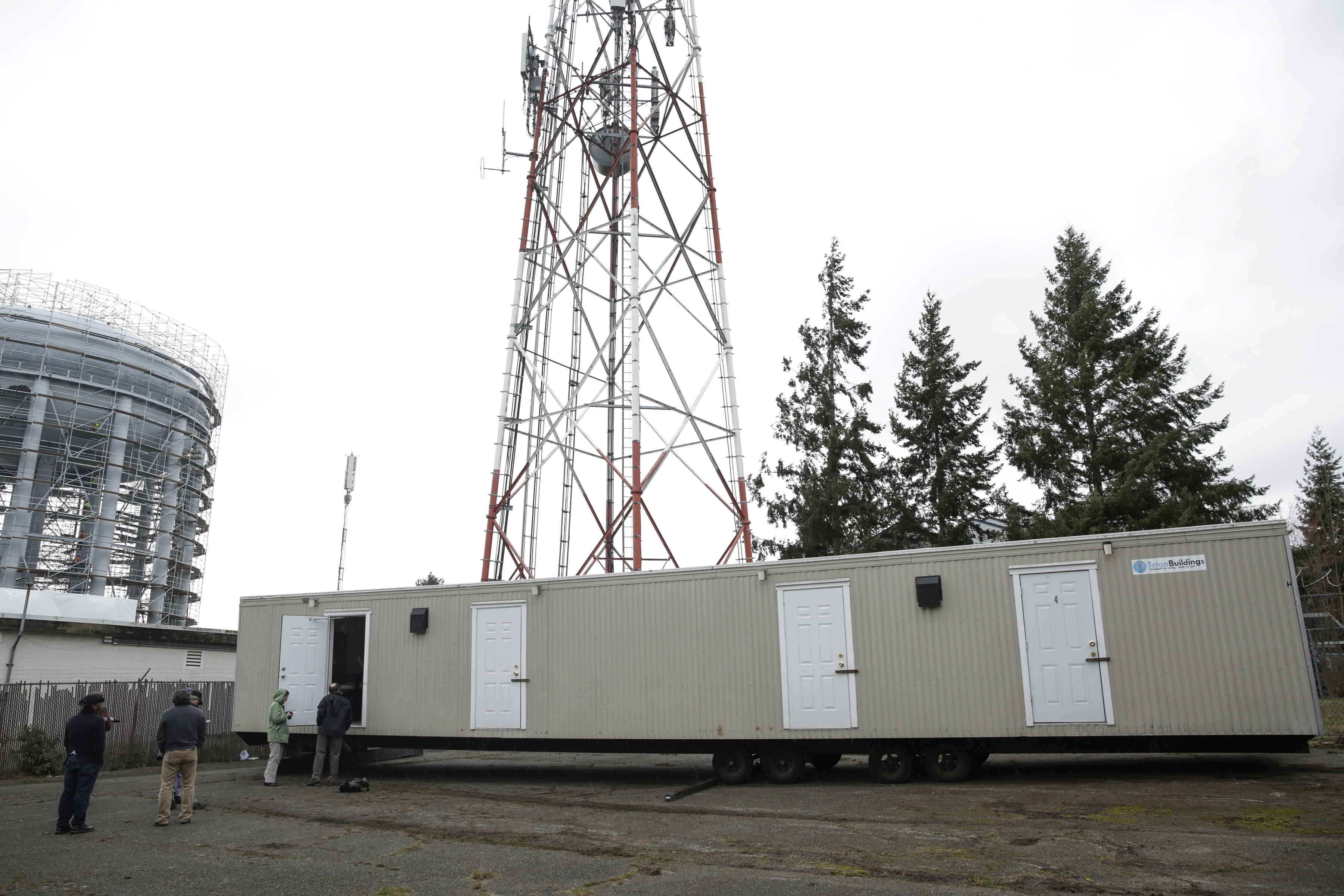 Media tours the first of 18 four-room modular housing units being prepared for patient accommodation during treatment and isolation in King County's response to coronavirus on a site in White Center, south of Seattle, Washington on Tuesday, March 3.