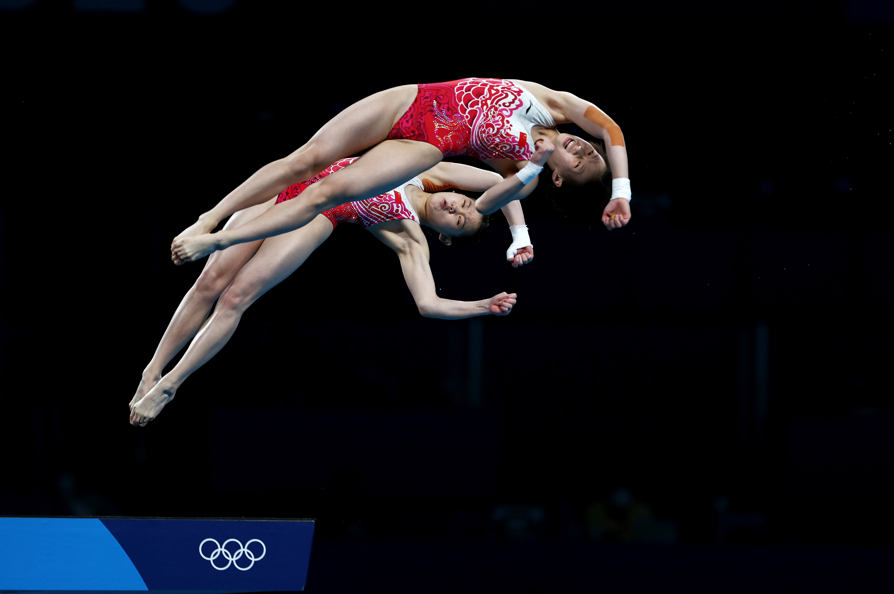 China's Chen Yuxi and Zhang Jiaqi compete in the 10m synchronized platform final on Tuesday, July 27.