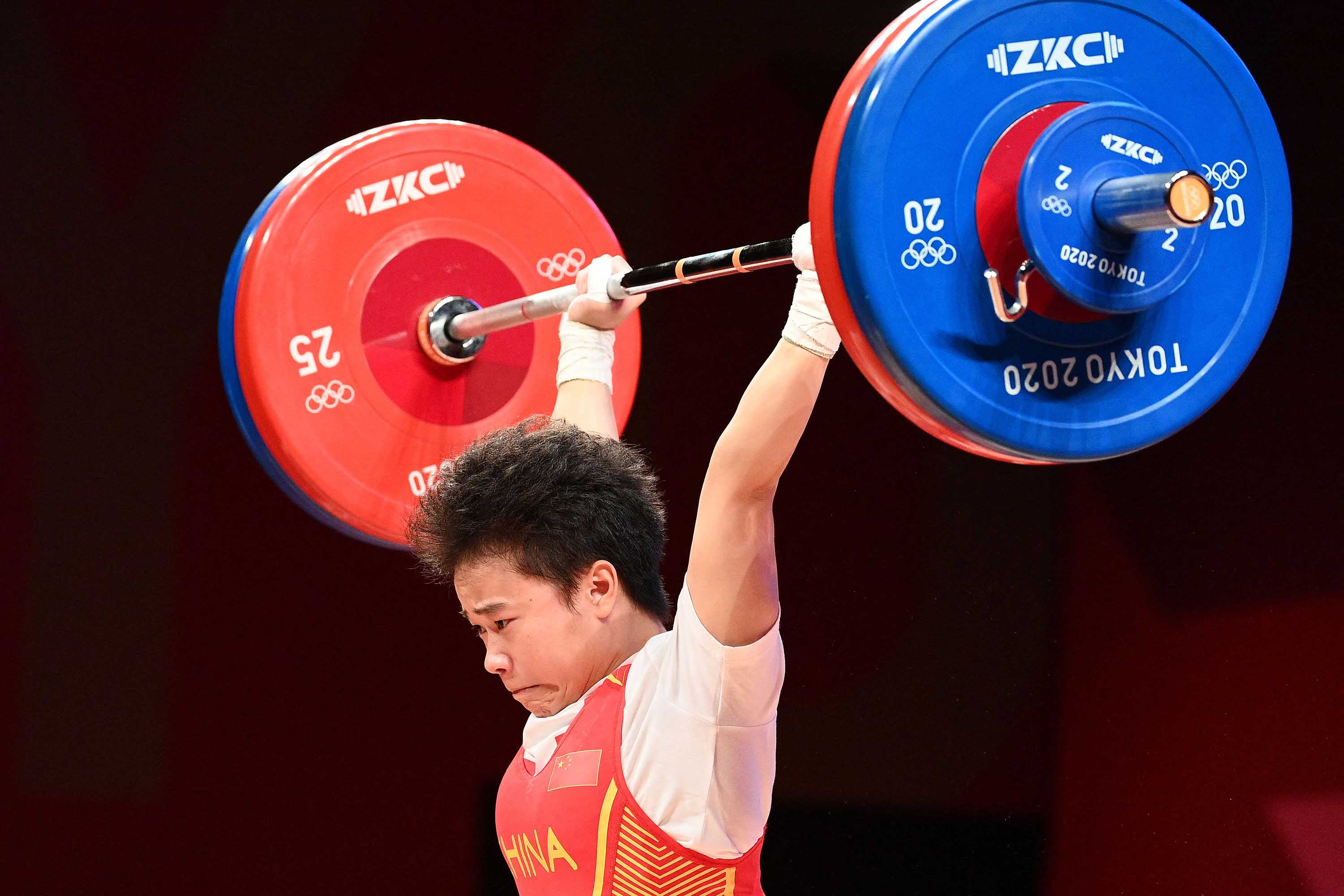 Zhihui competes in the women's 49kg weightlifting competition on Saturday.