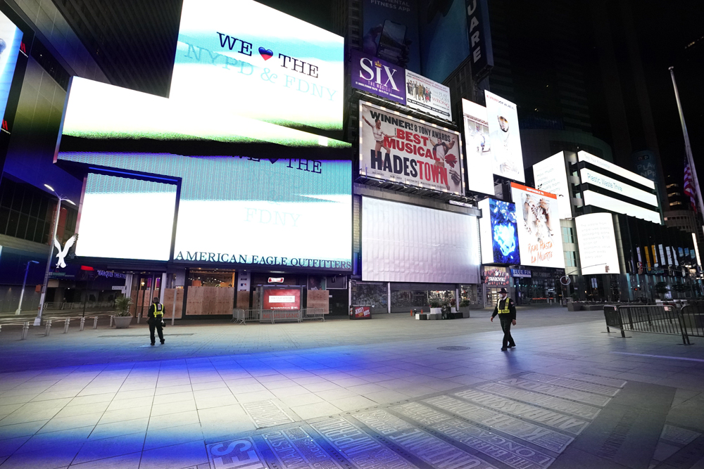 Security guards stand in a closed off Times Square shortly before the 11 p.m. curfew went into effect June 1.
