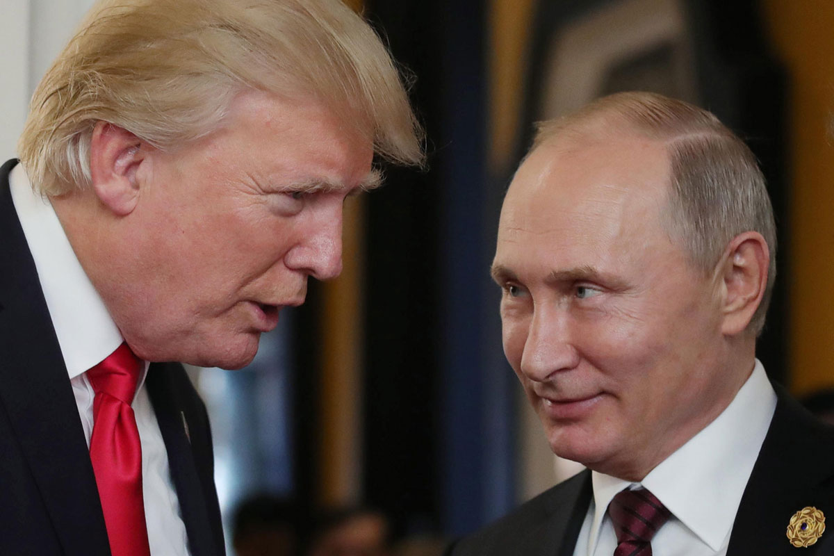 US President Donald Trump chats with Putin on the sidelines of the APEC Summit in Da Nang, Vietnam, in 2017.Trump said he took Putin at his wordthat Russia did not seek to interfere in the US presidential election in 2016, despite a finding from US intelligence agencies that it did.