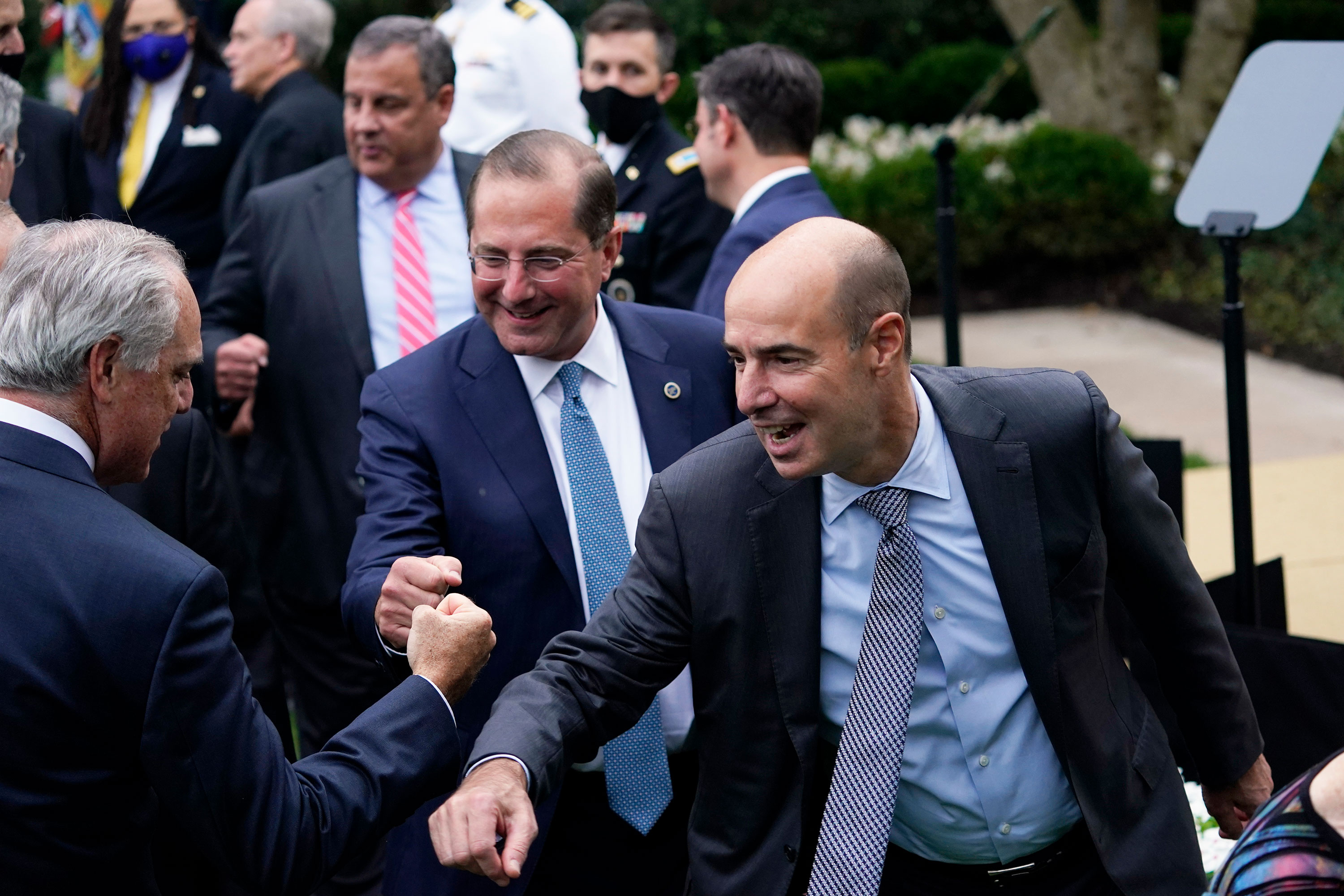 From right, Labor Secretary Eugene Scalia, Health and Human Services Secretary Alex Azar and former New Jersey Gov. Chris Christie greet people after President Donald Trump announced Judge Amy Coney Barrett as his nominee to the Supreme Court, in the Rose Garden at the White House on September 26 in Washington, DC.