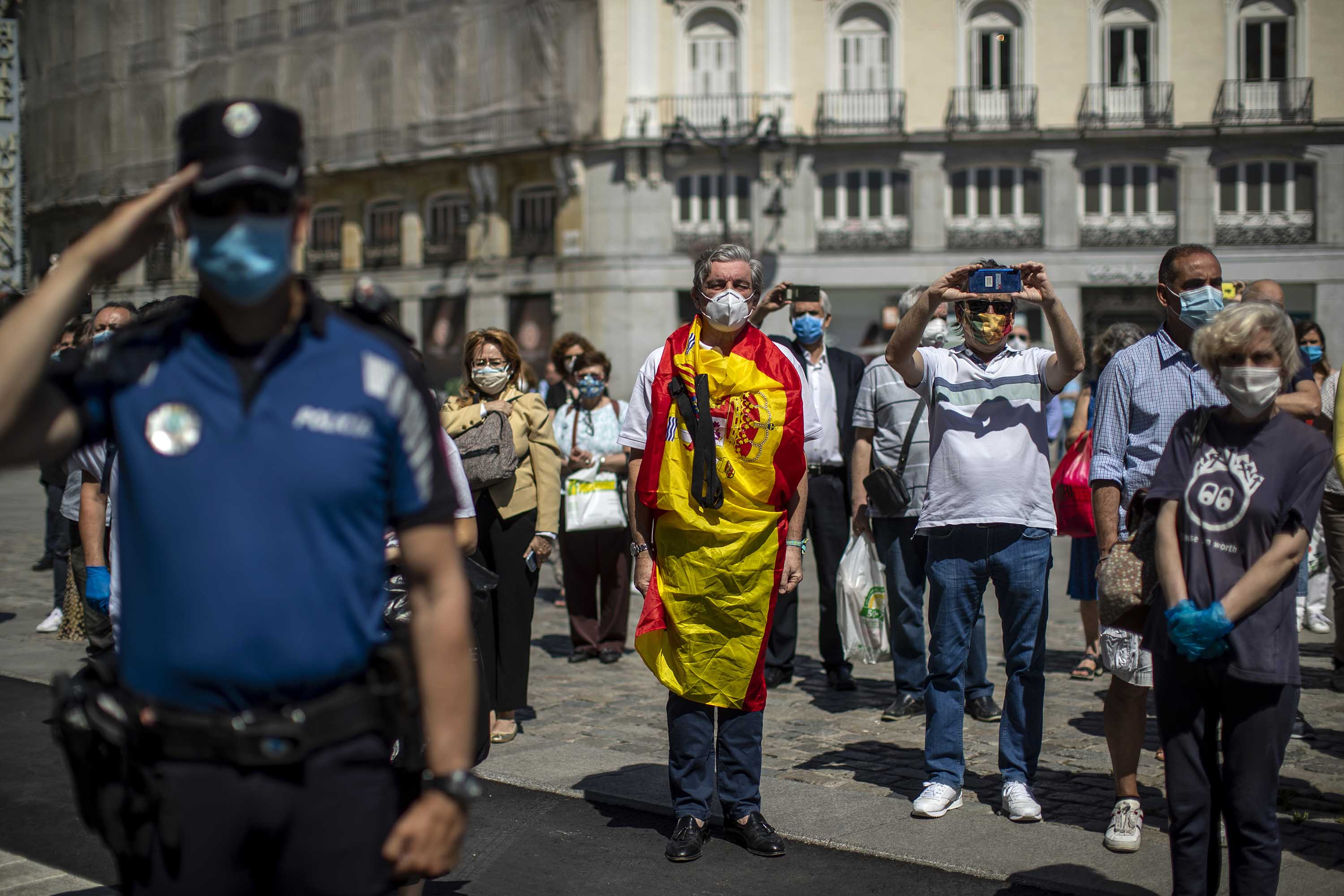 People hold a minute of silence for the victims of Covid-19 in Madrid, Spain, on Wednesday, May 27.