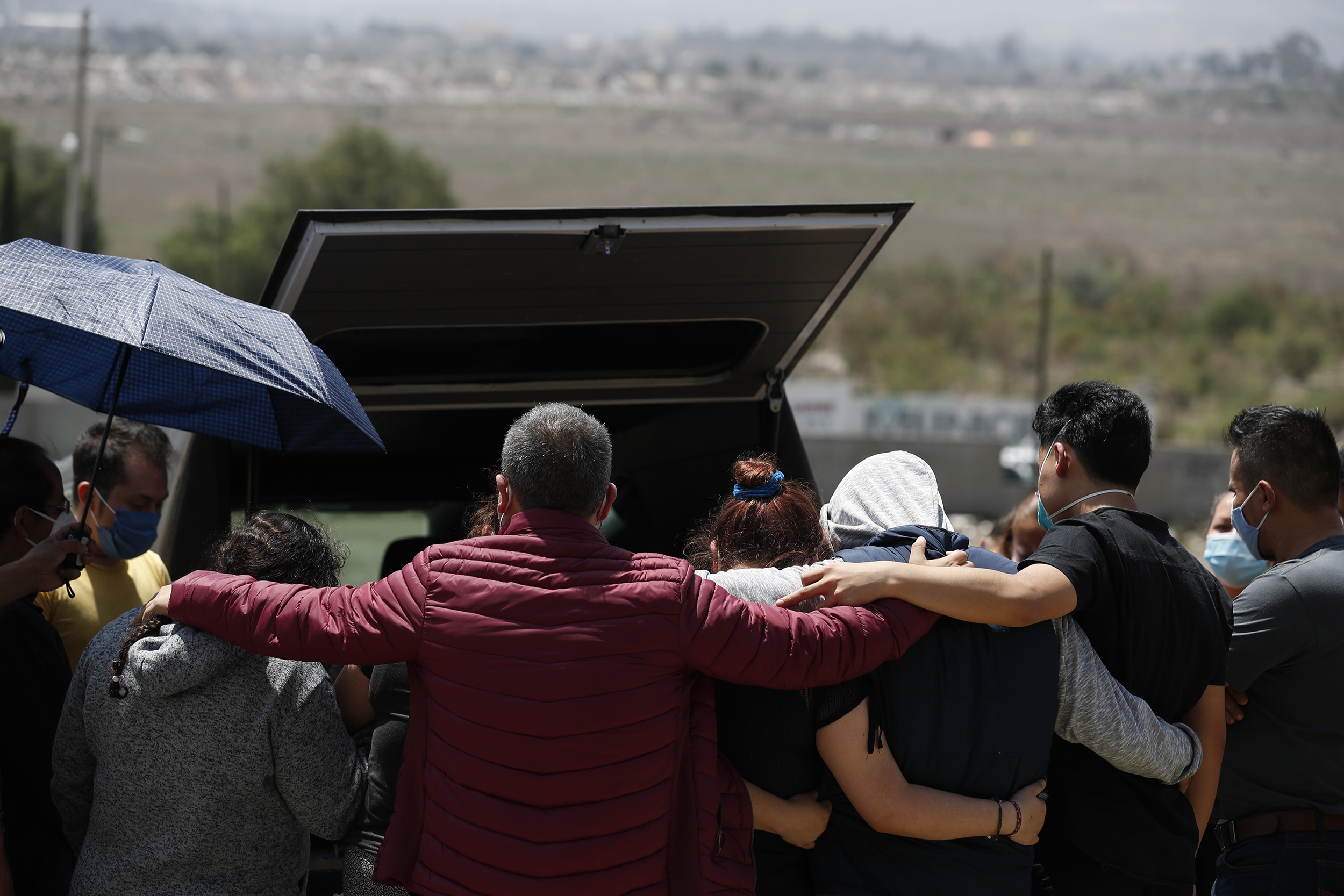 A family prepares to bury a suspected Covid-19 victim in Mexico City on July 2.