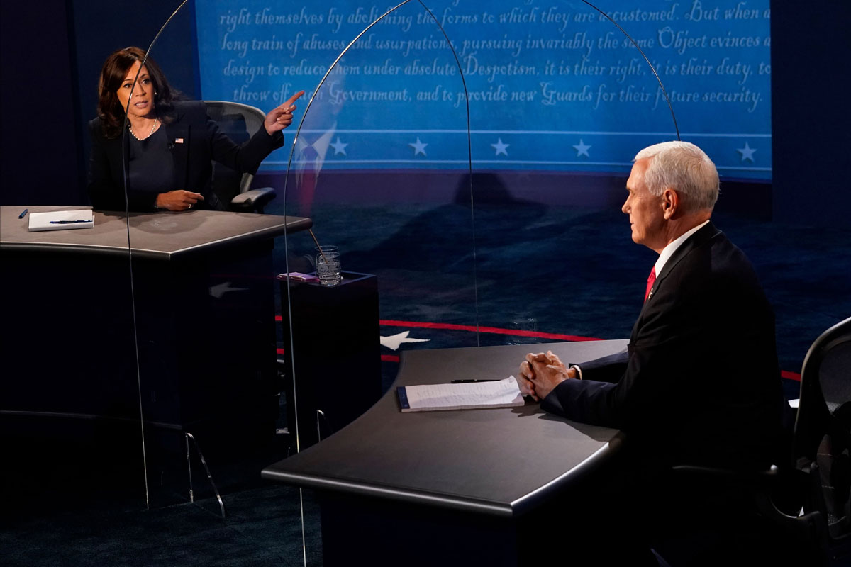 Vice President Mike Pence listens as Democratic vice presidential candidate Kamala Harris speaks during the vice presidential debate in Kingsbury Hall at the University of Utah on October 7.