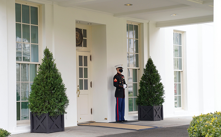 The entrance to the West Wing is seen with a Marine standing guard, indicating President Trump was in the Oval Office at the White House on Monday, January 18, in Washington, D.C.