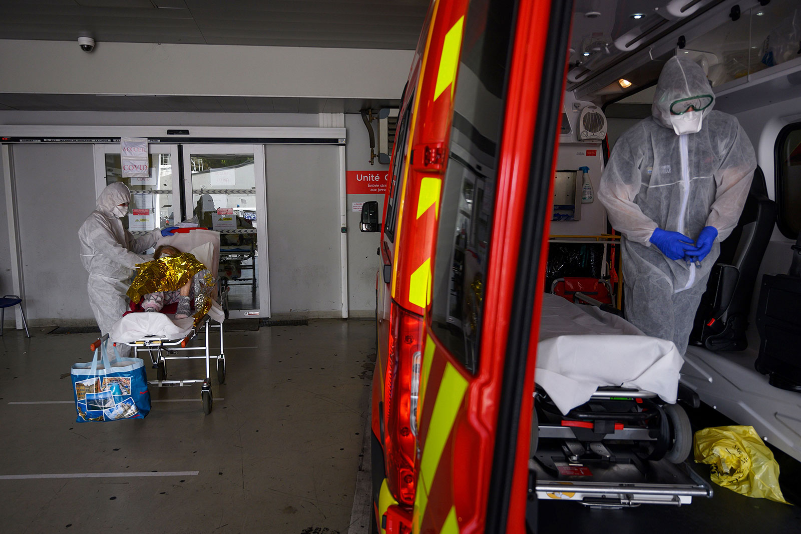 Firefighters bring a suspected coronavirus patient to a hospital in Marseille, France, on April 15.