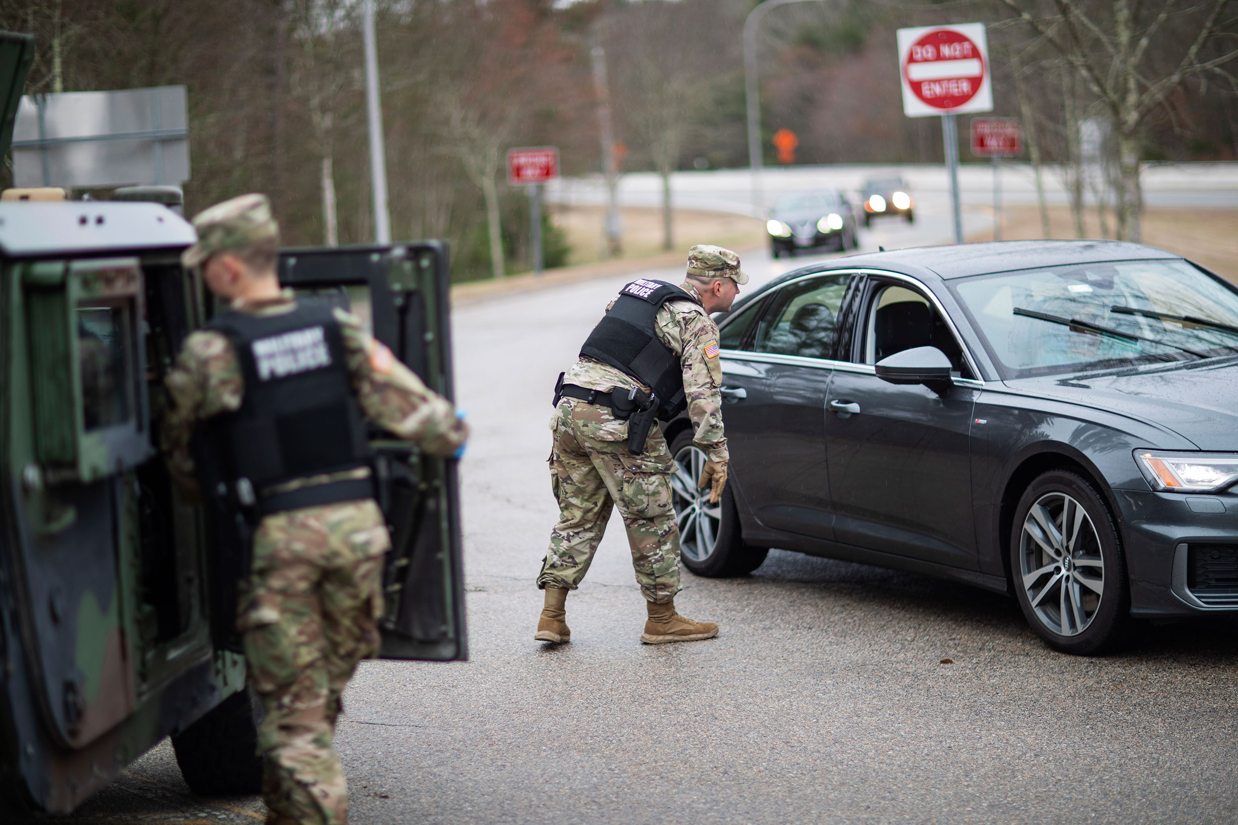 A member of the Rhode Island National Guard Military Police directs a motorist with New York license plates at a checkpoint on the border of Connecticut and Hope Valley, Rhode Island on March 28. New Yorkers had to pull over and provide contact information and were told to self-quarantine for two weeks.