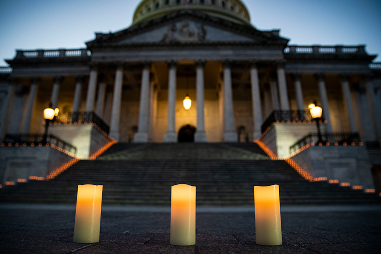 Candles are placed before a candlelight vigil and moment of silence outside the U.S. Capitol, on February 23, 2021 in Washington, DC. Congressional leaders held a candlelight ceremony to mark the more than 500,000 U.S. deaths due to the COVID-19 pandemic.