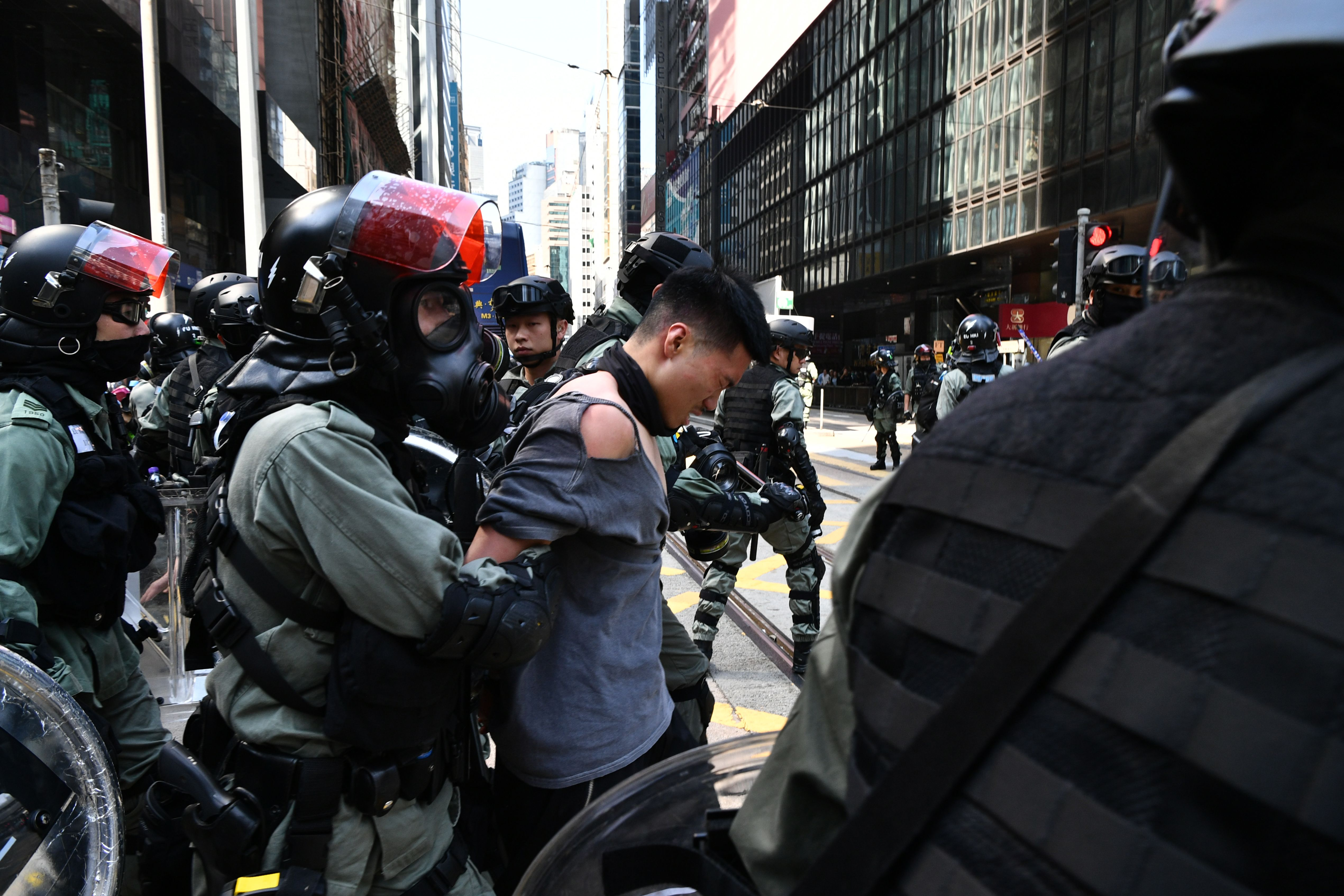 A man is detained by riot police during a protest in Hong Kong on November 11, 2019.