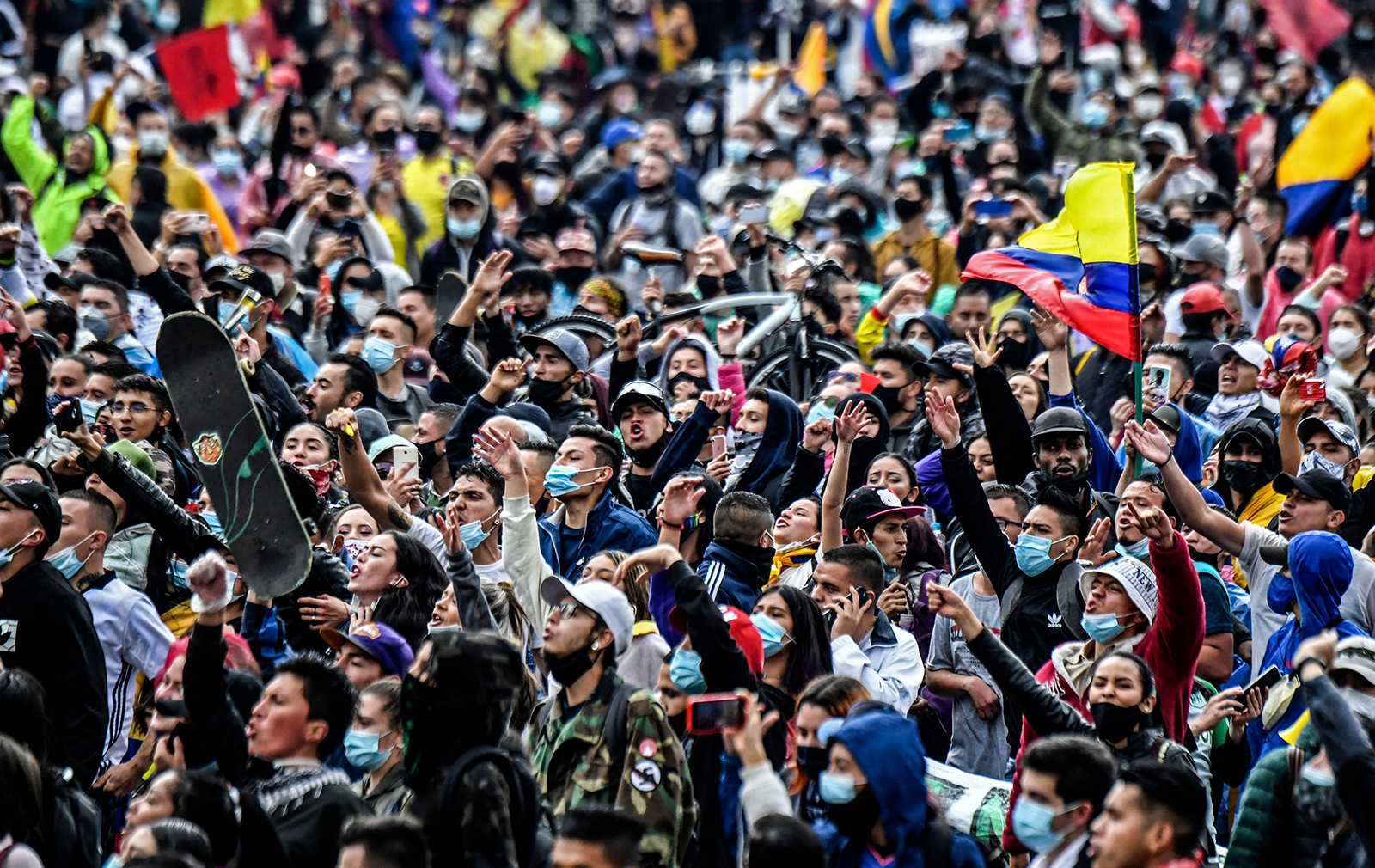 People take part in a protest against a tax reform bill launched by Colombian President Ivan Duque, in Bogota, Colombia, on April 28.