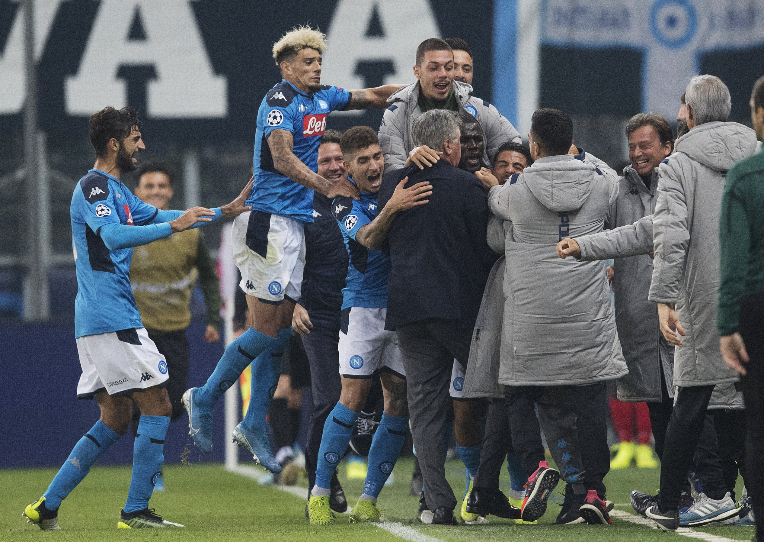 Napoli players celebrate the winning goal against Salzburg.