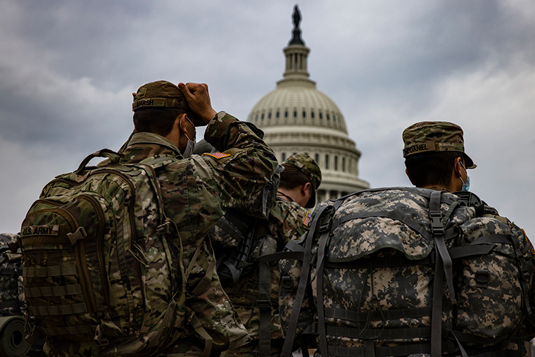 National Guard soldiers prepare for their guard shifts at the US Capitol building on Friday, January 15, in Washington, DC.