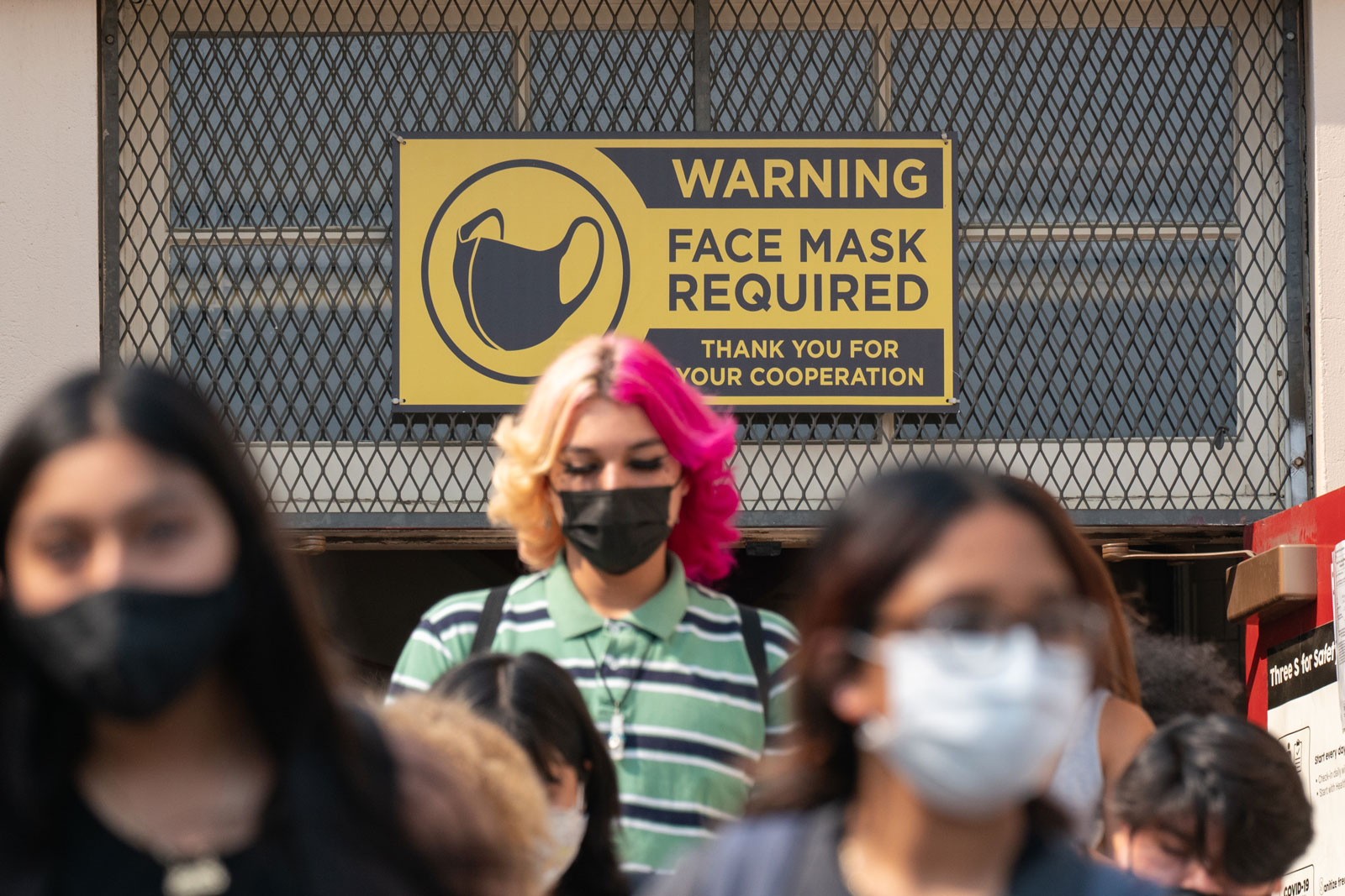 Students exit Hollywood High School after the first day of school in Los Angeles, California on Aug. 16.