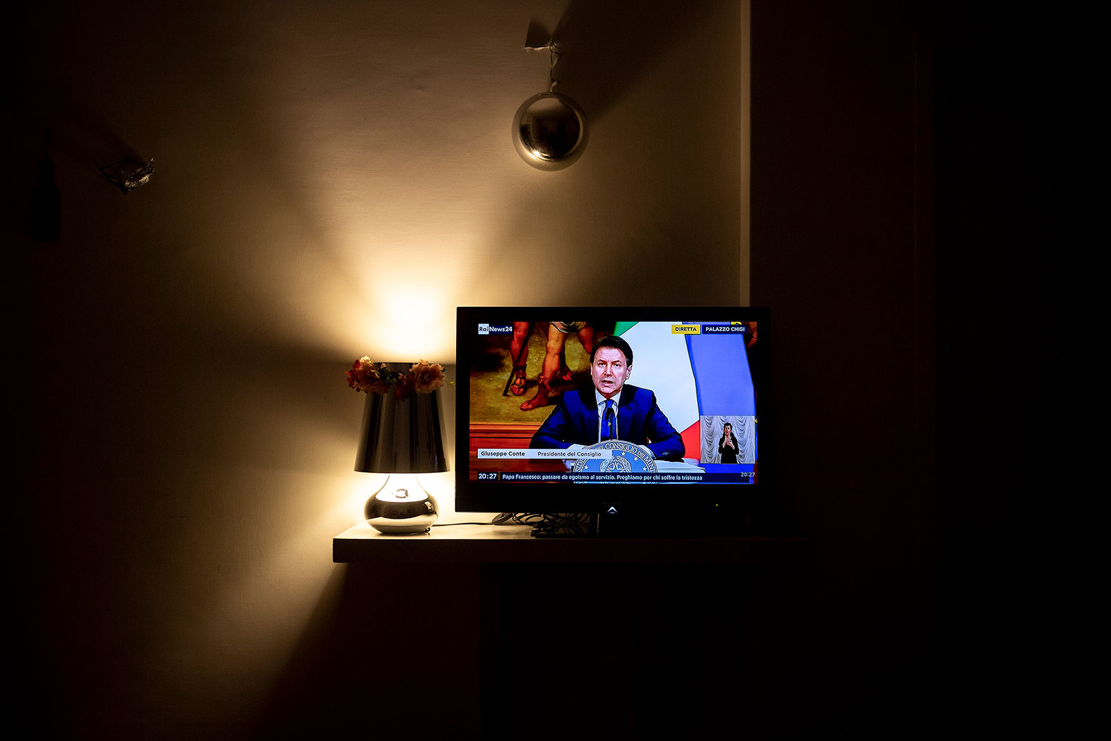 Italian Prime Minister Giuseppe Conte announces plans to loosen lockdown restrictions across the country during a television broadcast on April 26.