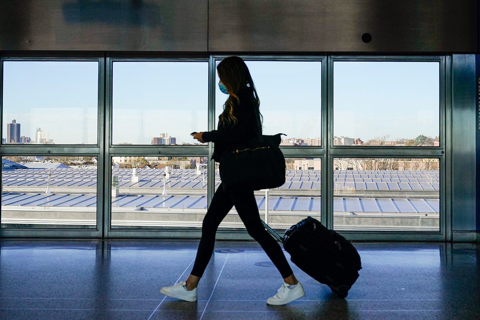 A traveler approaches the AirTrain to JKF International Airport in New York, on November 20.