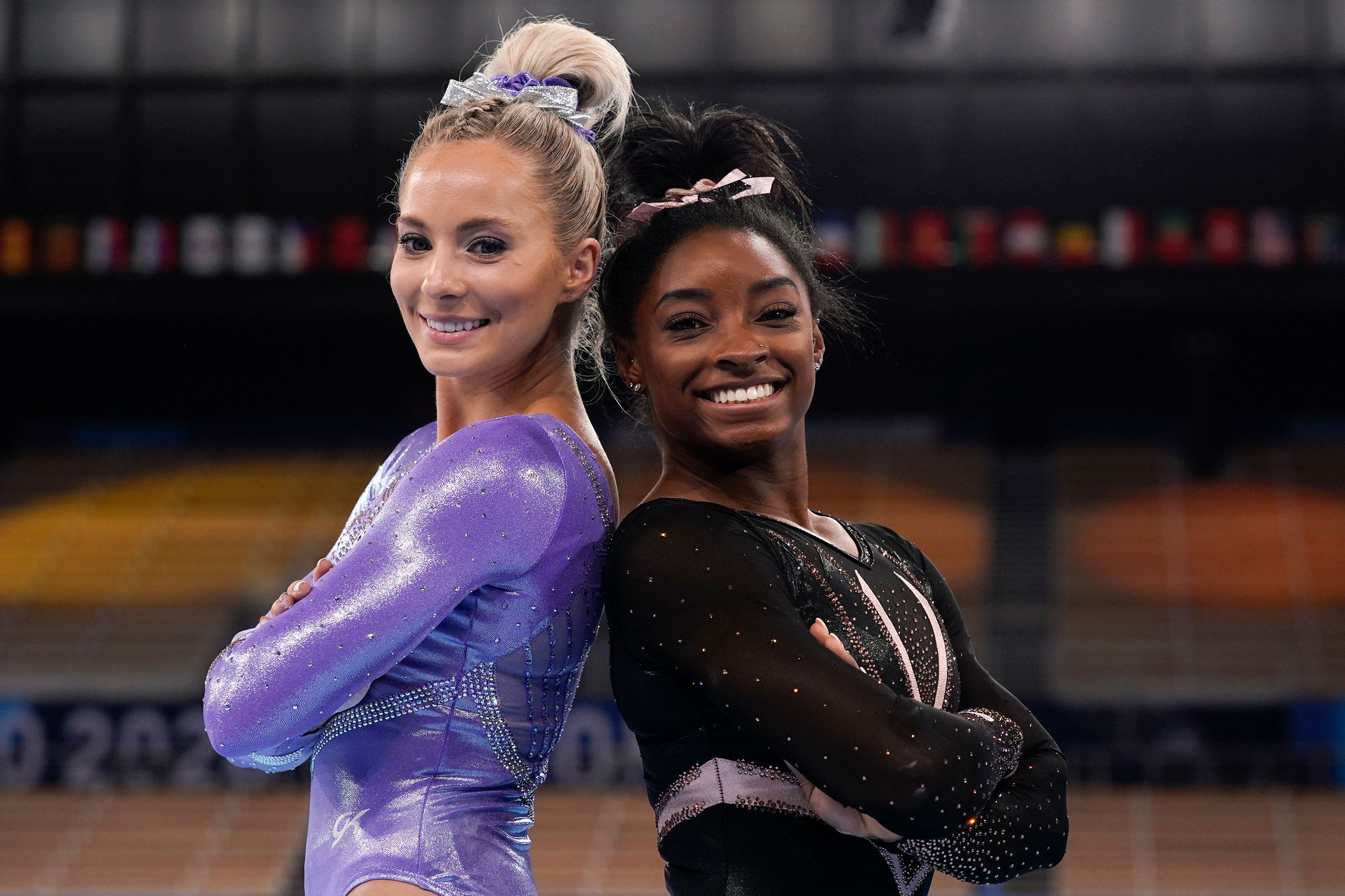 MyKayla Skinner and Simone Biles pose for pictures after a practice session on July 22.