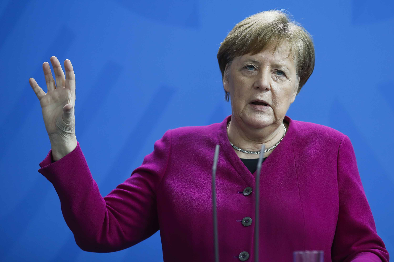 German Chancellor Angela Merkel briefs the media in Berlin on April 9.
