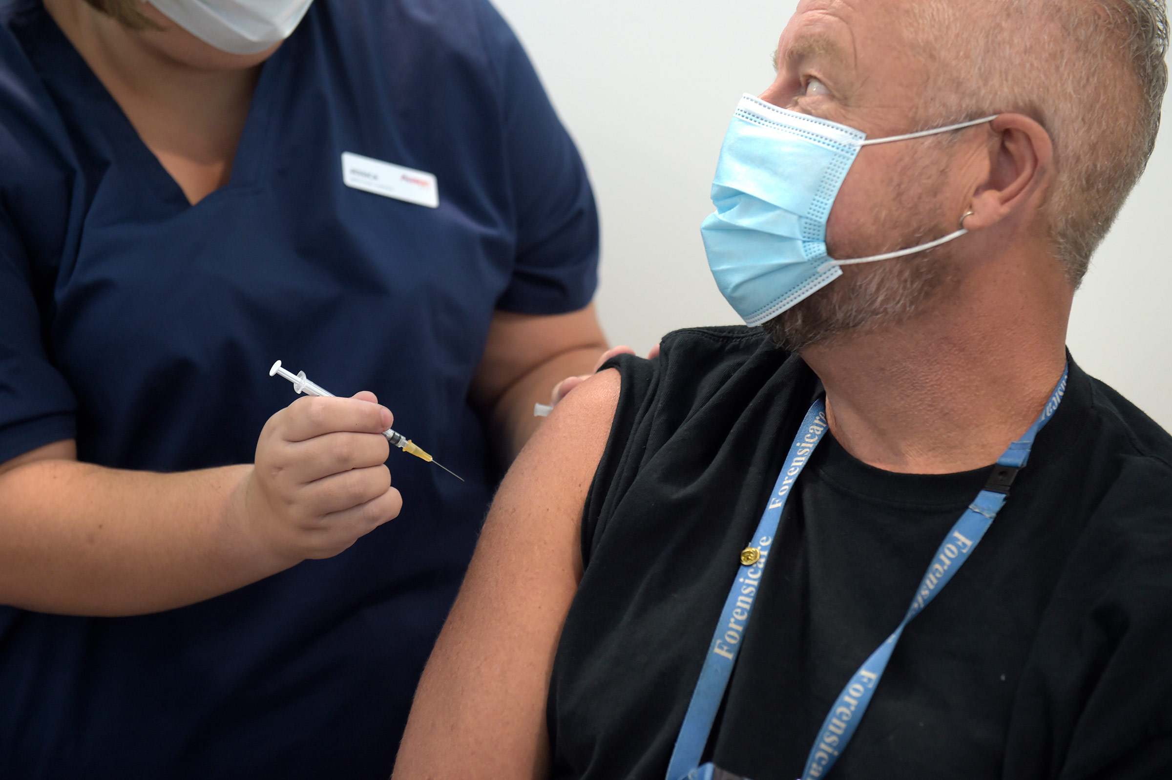 A health worker receives a dose of the Pfizer/BioNTech Covid-19 vaccine in Melbourne, Australia, on Monday, February 22.