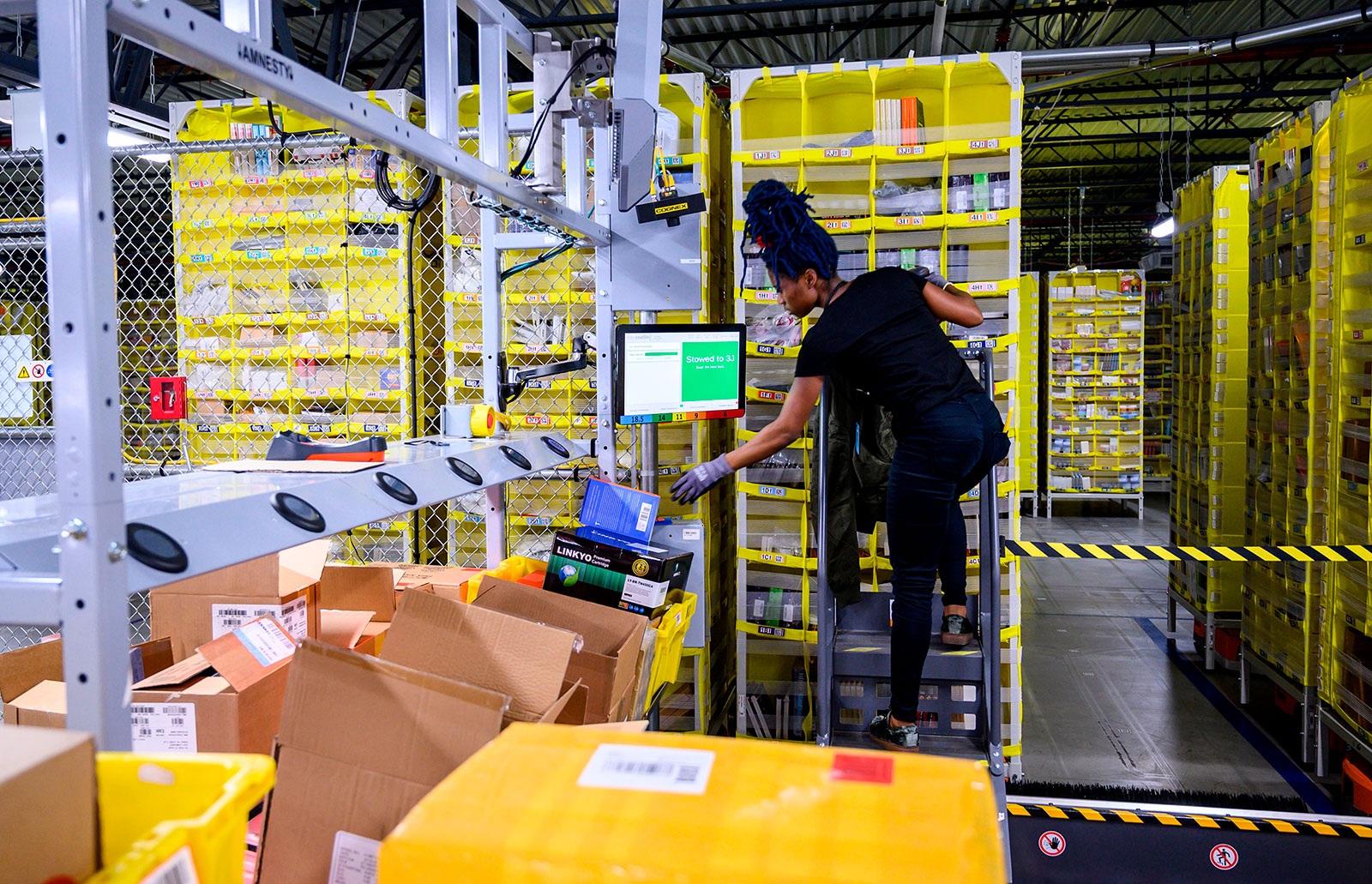 An employee works at the Amazon fulfillment center in Staten Island in 2019.