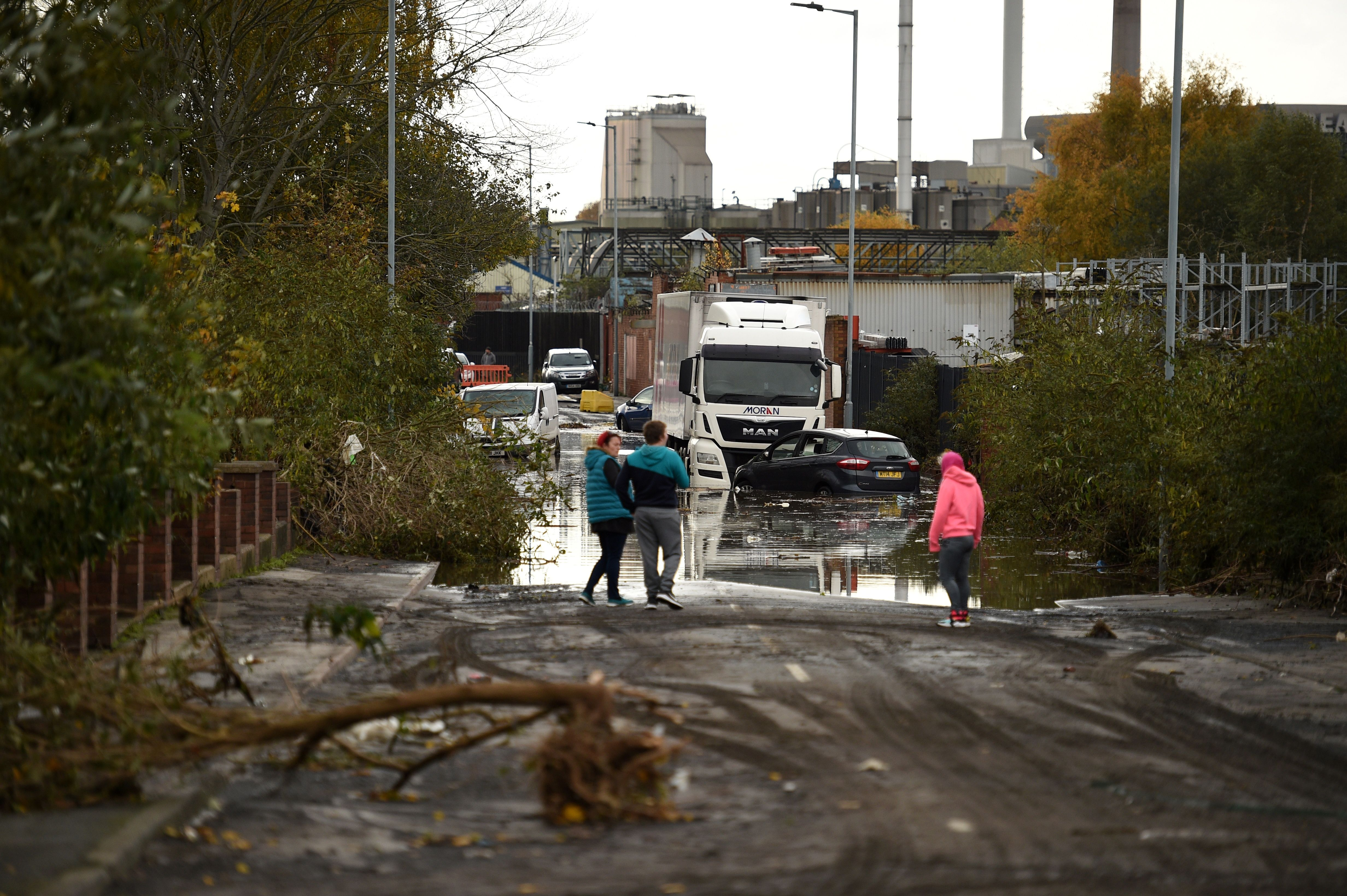 Residents look at the aftermath in Rotherham, northern England.
