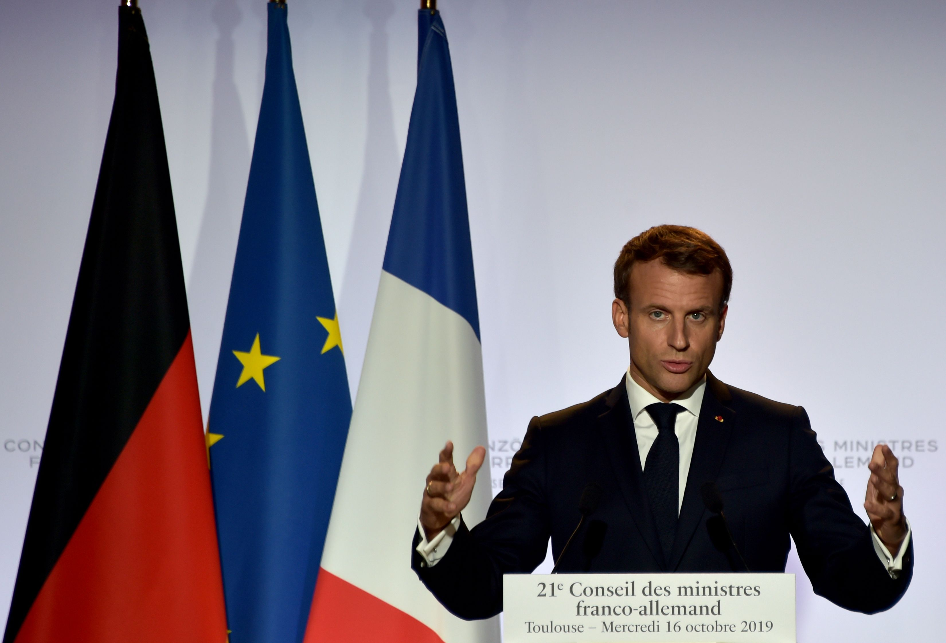 French President Emmanuel Macron during a press conference with German Chancellor Angela Merkel in Toulouse, southwestern France, on Thursday.