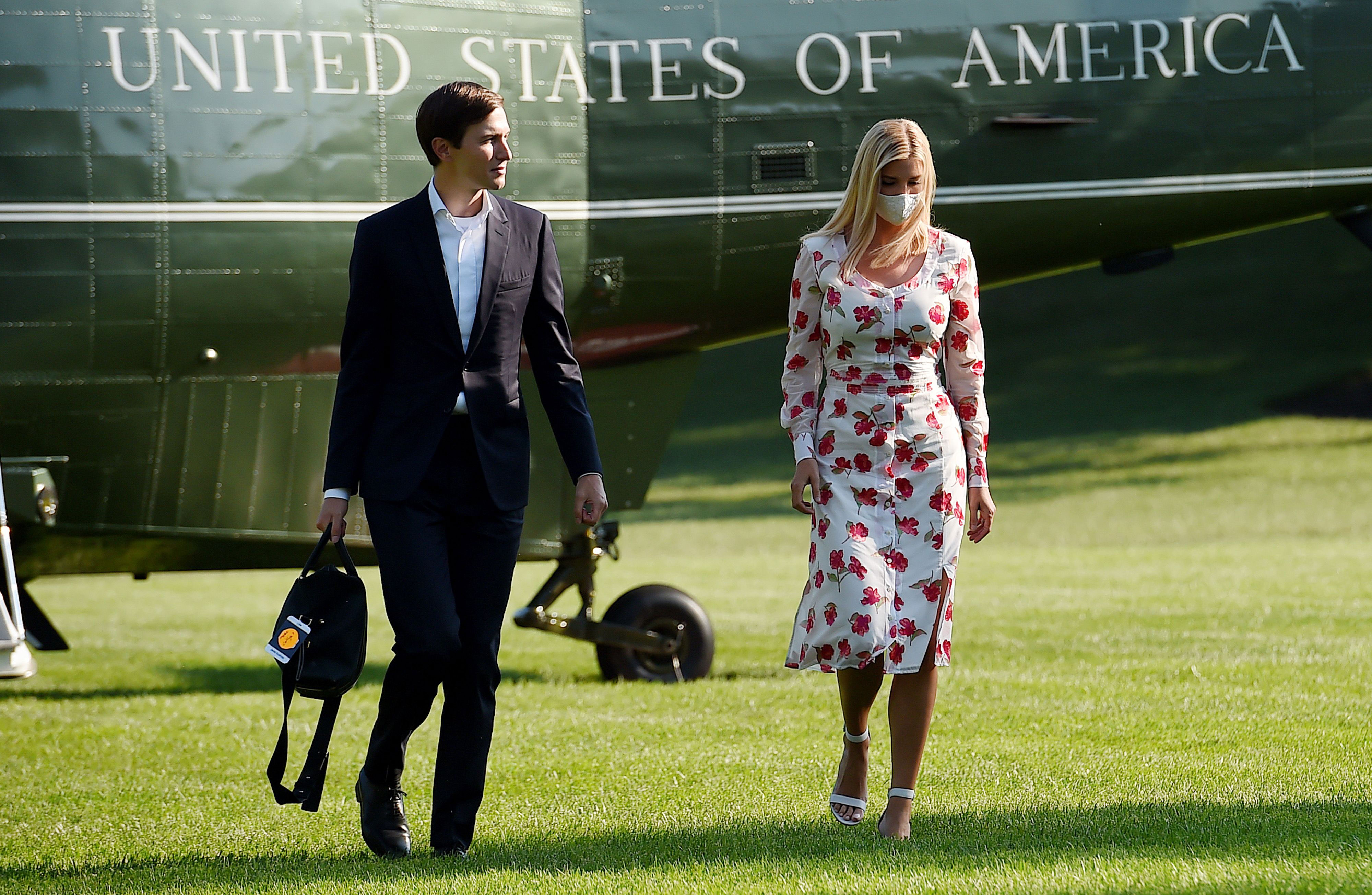 Jared Kushner and Ivanka Trump walk off Marine One at the White House on July 26.