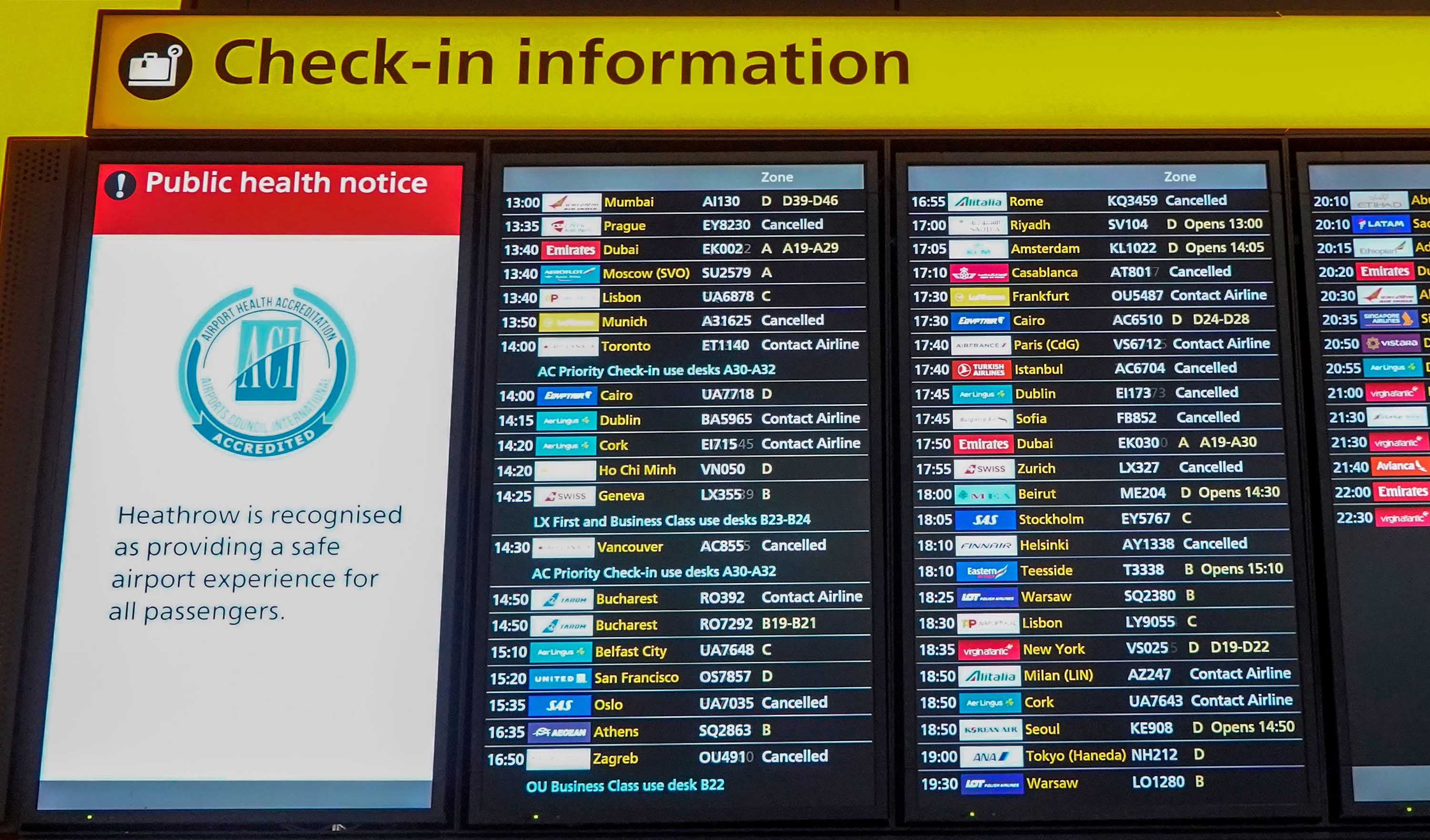"An electronic information display board shows the ""cancelled"" status of flights, including those bound for Dublin, Istanbul, and Munich among others, in the departures hall at Terminal 2 of Heathrow Airport in London, on December 21."