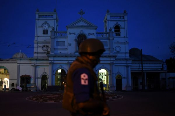 A security official stands guard outside St. Anthony's Shrine in Colombo in the early hours of April 23, 2019, two days after the church was hit in a series of bomb blasts targeting churches and luxury hotels in Sri Lanka.