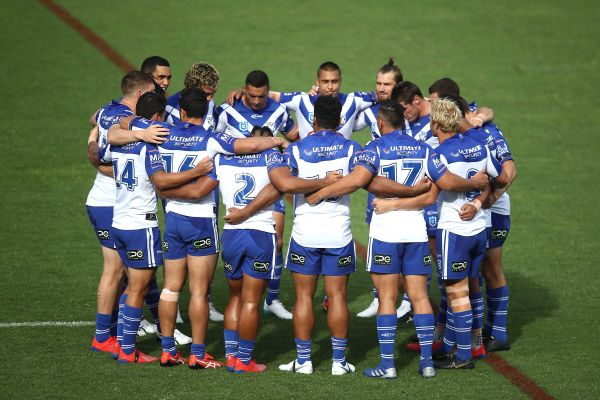 Canterbury Bulldogs players observe a moment of silence before their Rugby League match in Auckland, New Zealand on Saturday.