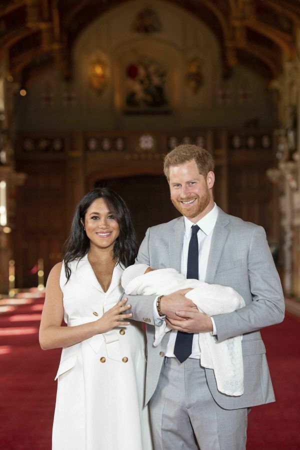 Britain's Prince Harry and Meghan, Duchess of Sussex, during a photocall with their newborn son, in St George's Hall at Windsor Castle.