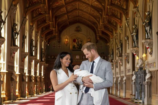Britain's Prince Harry and Meghan, Duchess of Sussex, during a photocall with their newborn son, in St George's Hall at Windsor Castle, Windsor.