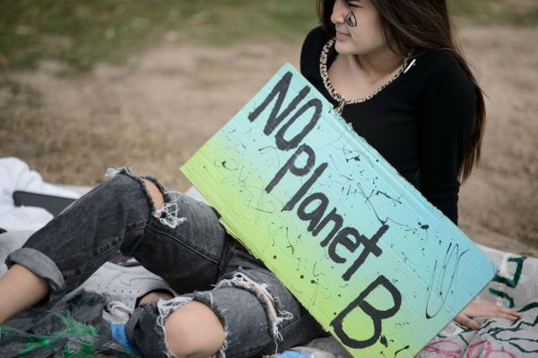 An activist sits during a youth climate rally on the west front of the US Capitol on March 15, 2019 in Washington, DC.