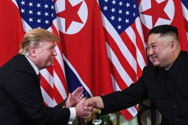Trump shakes hands with Kim in Hanoi on Wednesday.
