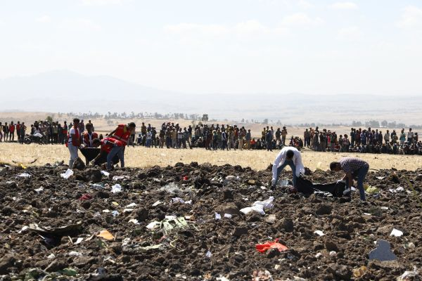 Rescue teams collect remains of bodies amid debris at the crash site of Ethiopia Airlines near Bishoftu, a town some 60 kilometres southeast of Addis Ababa, Ethiopia, on March 10, 2019.